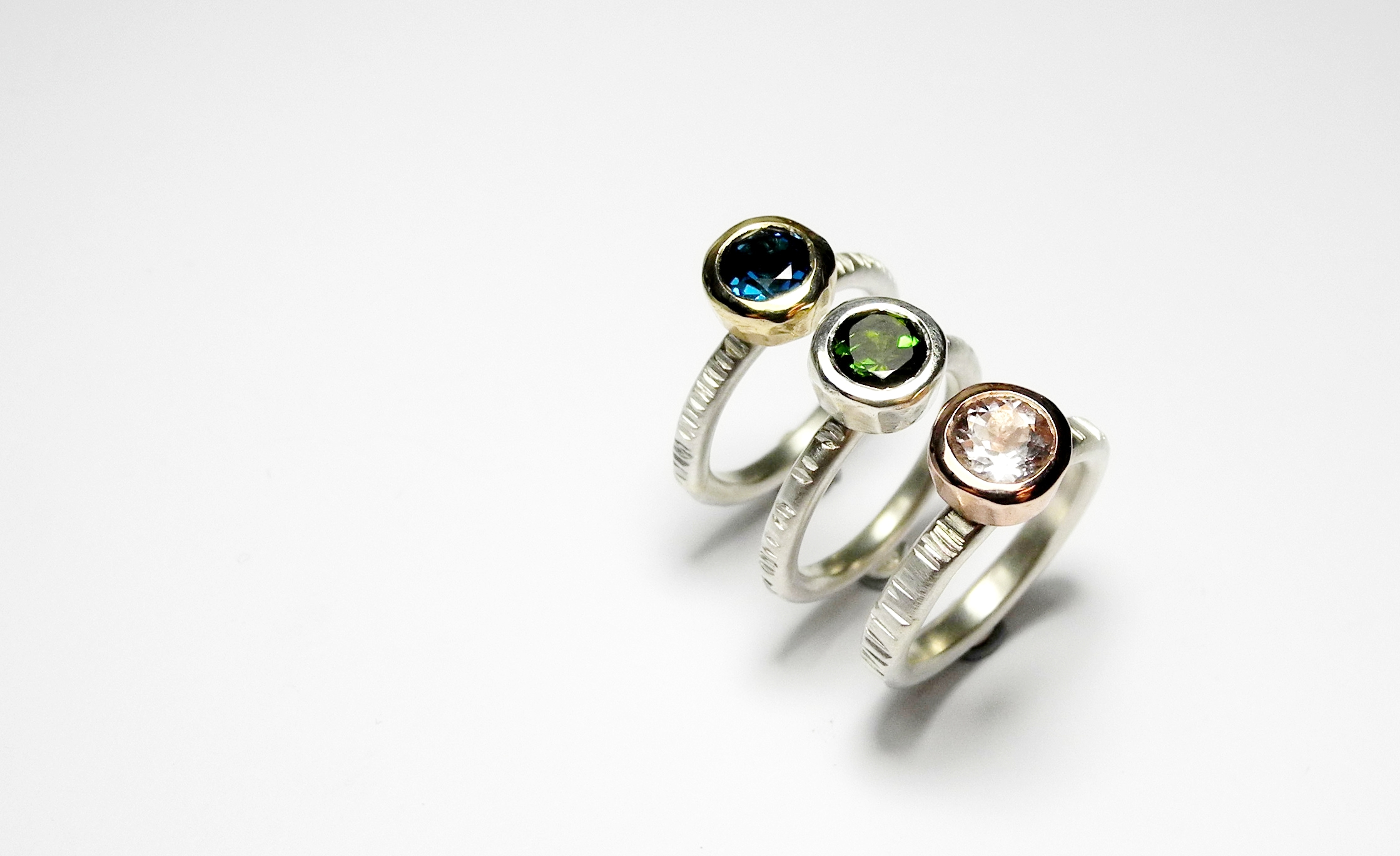 Juno rings in silver and gold with stones of your choice