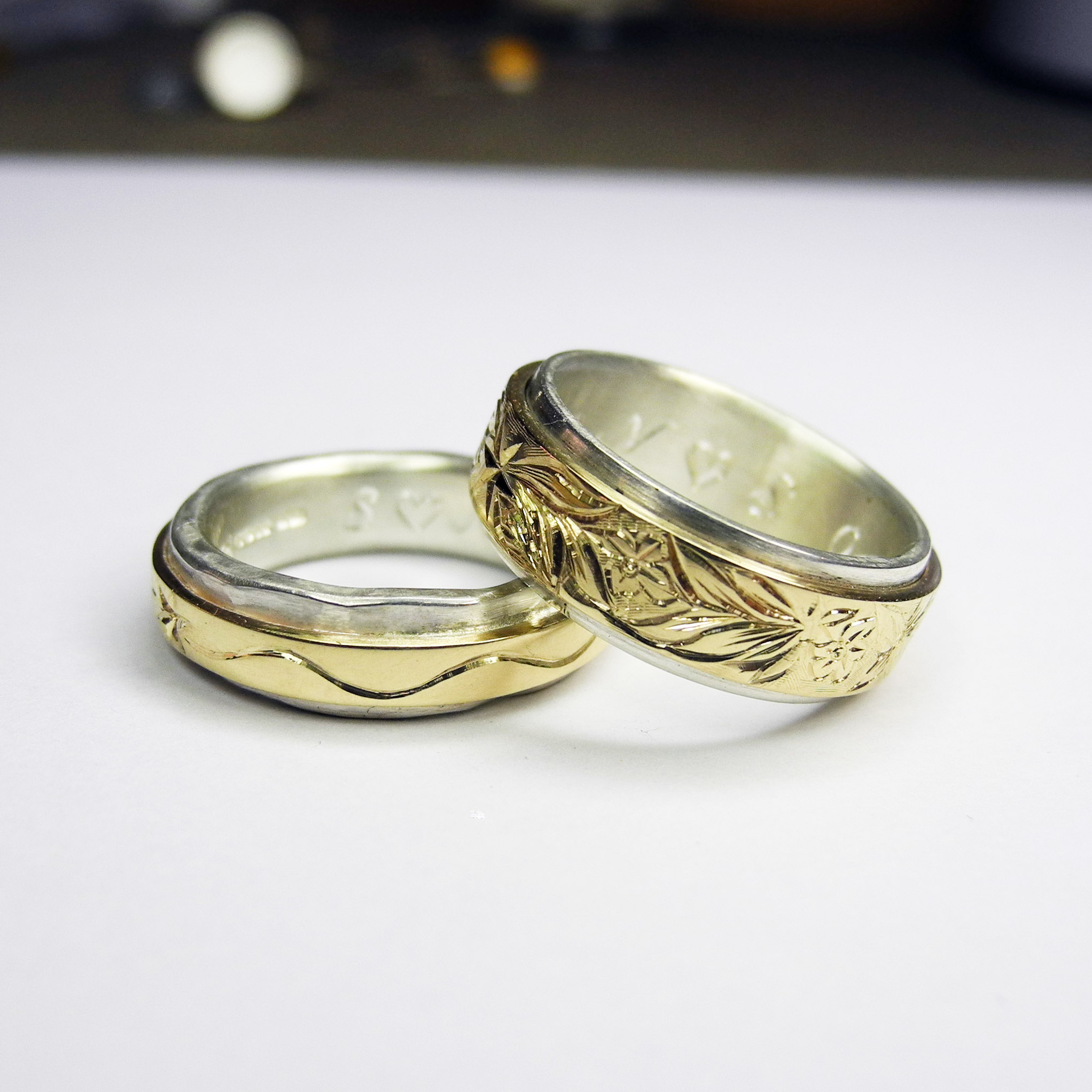 Gold wrapped around silver and engraved.