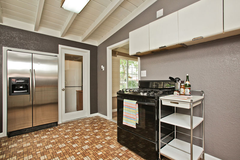 ...modern paint color and accessories transform cabinets and flooring from old and tired to retro-chic