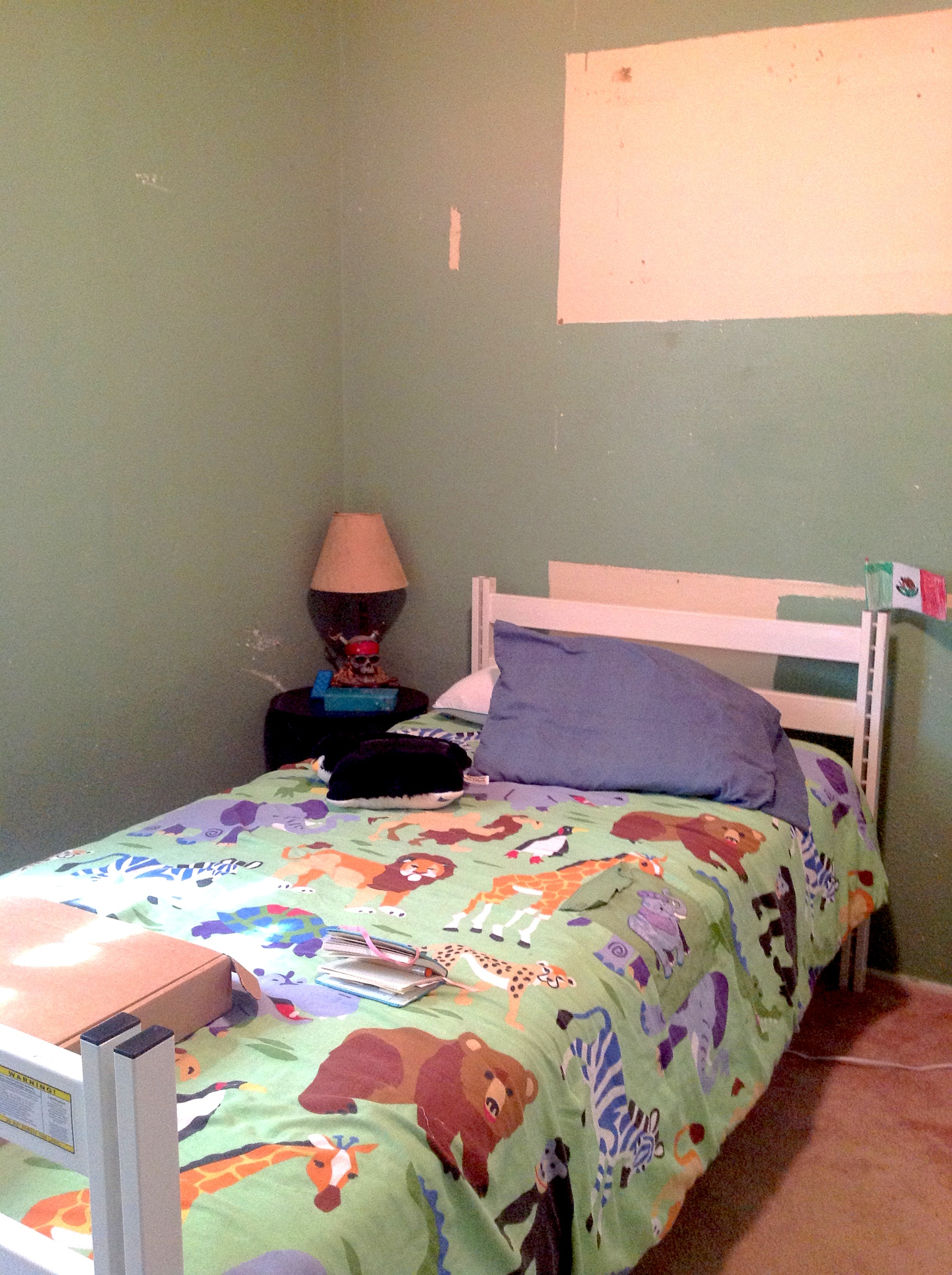 BEFORE: Child's bedroom with unfinished paint