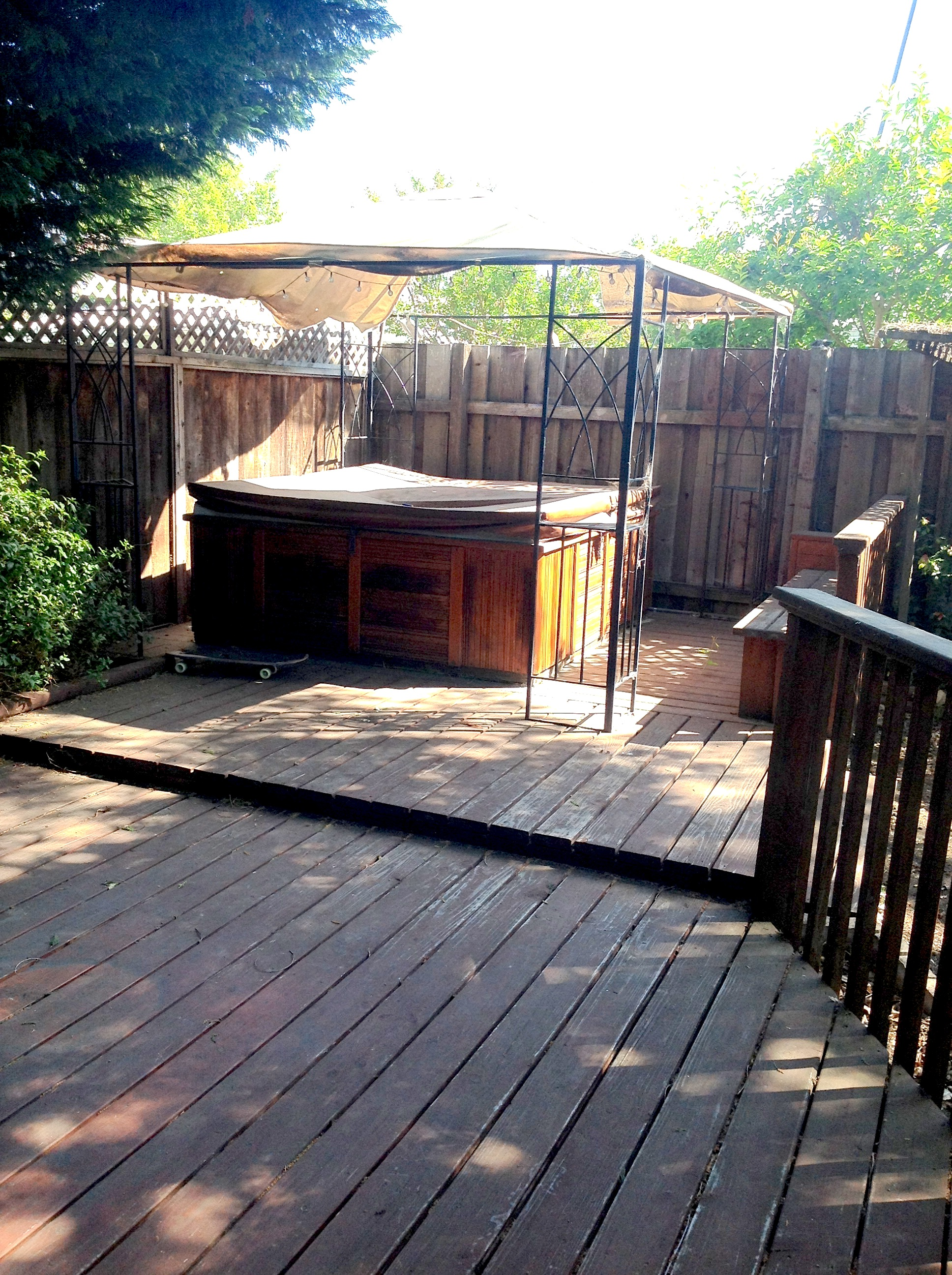 BEFORE: Backyard deck and hot tub