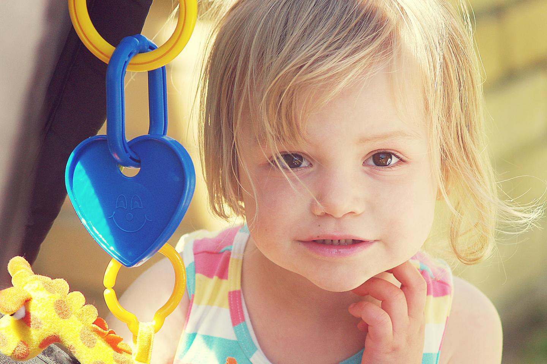 Little girl looking through the pram!