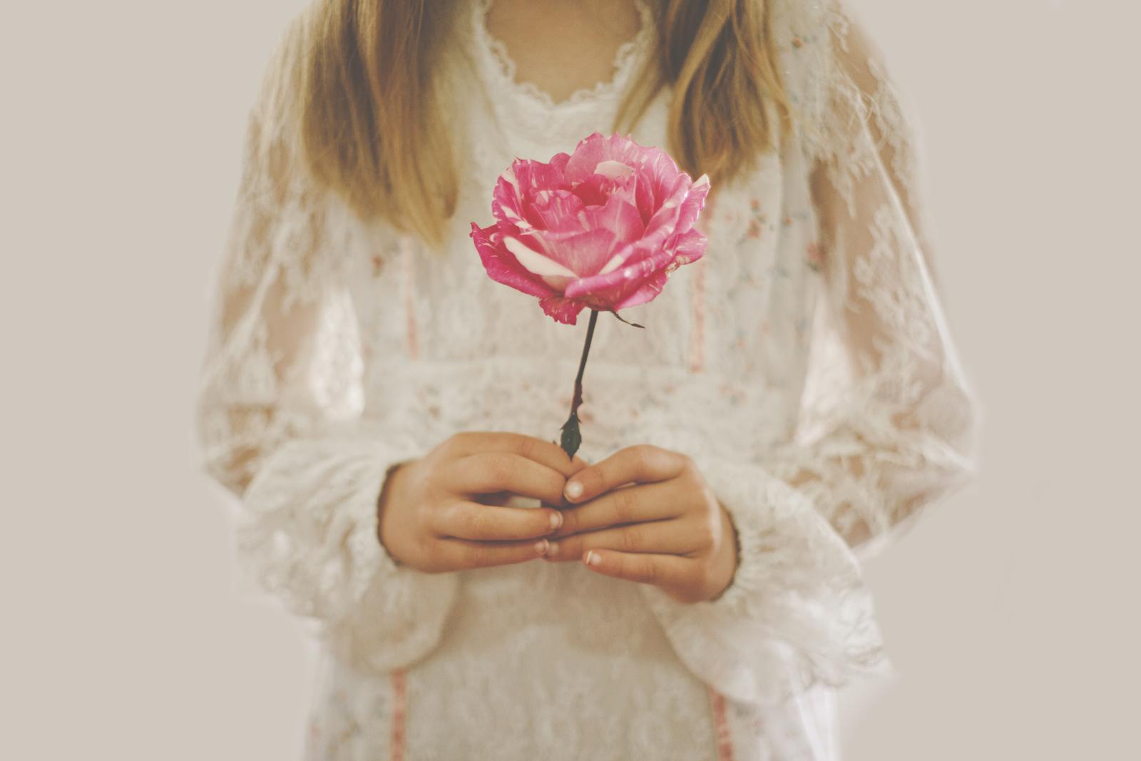 Little girl holding rose!