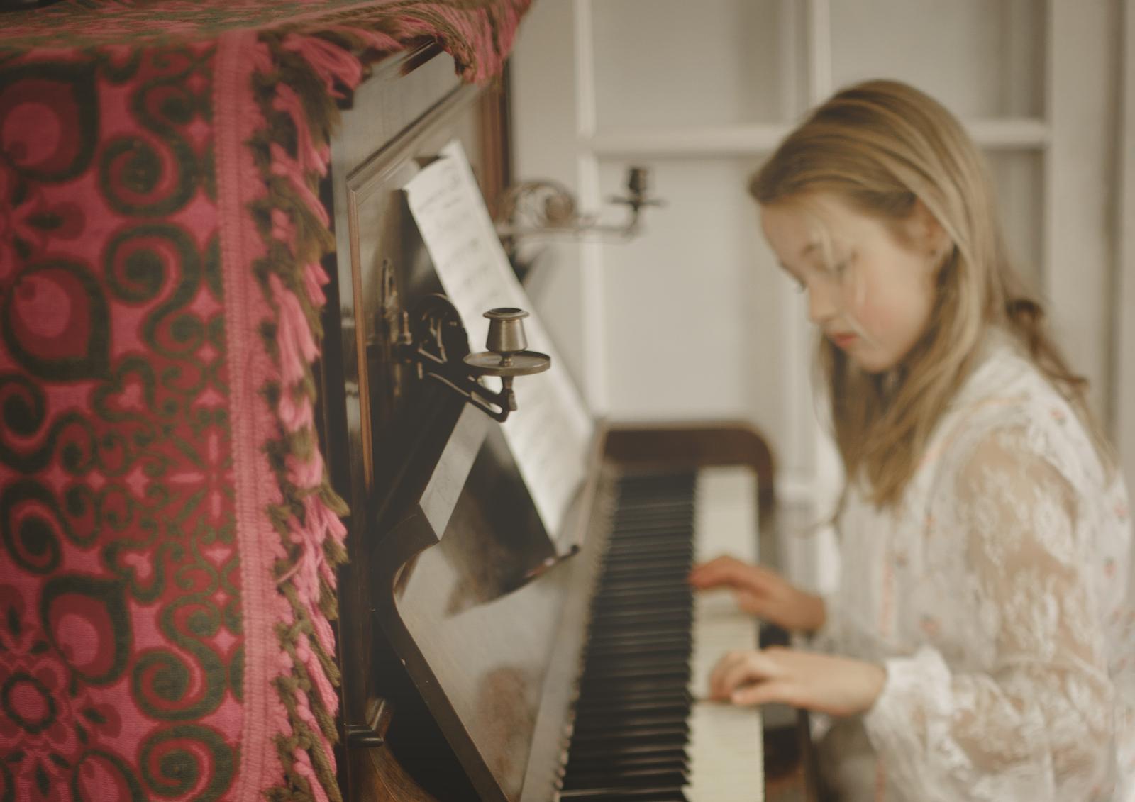 Little girl on piano!