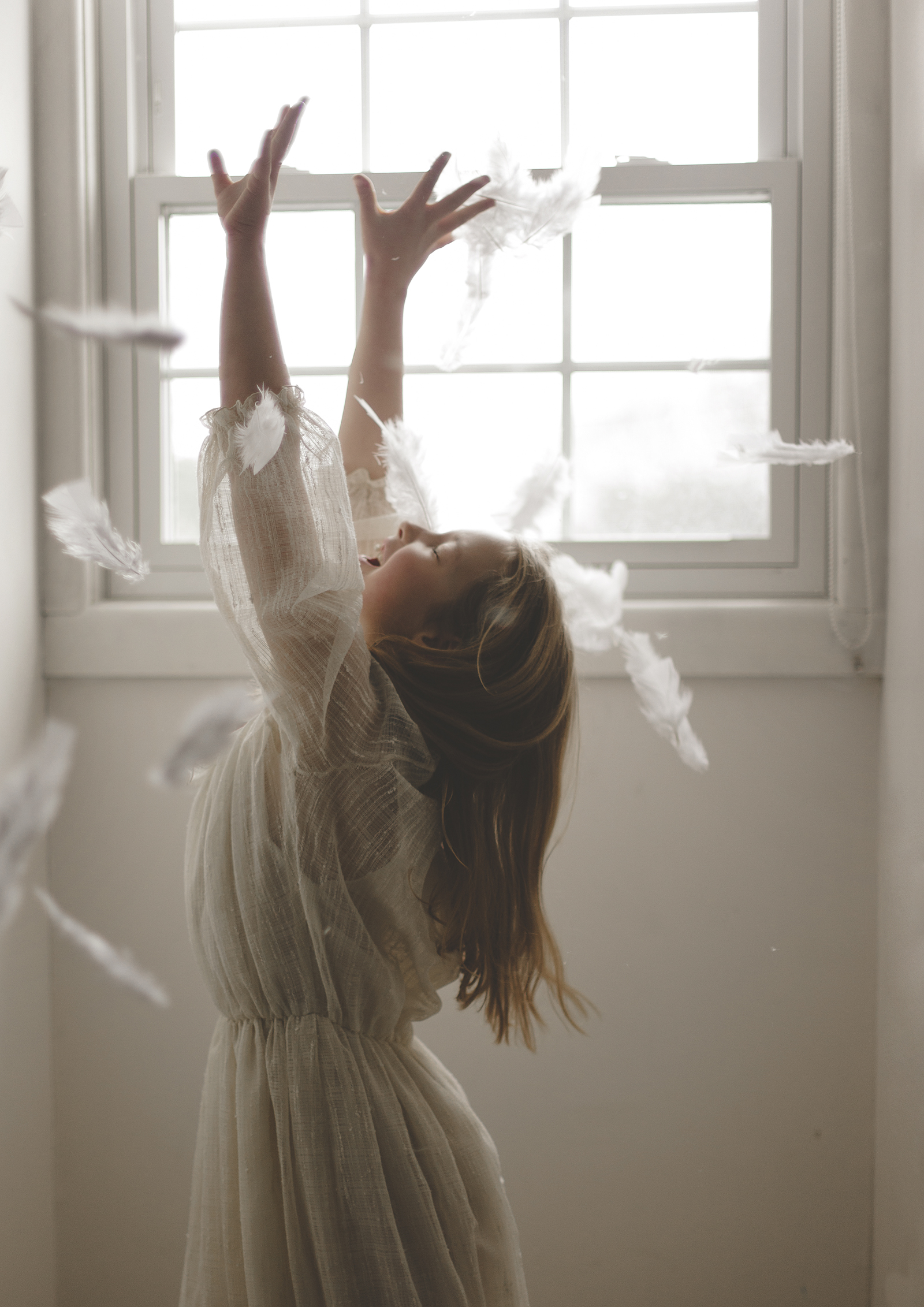 Girl catching falling feather!