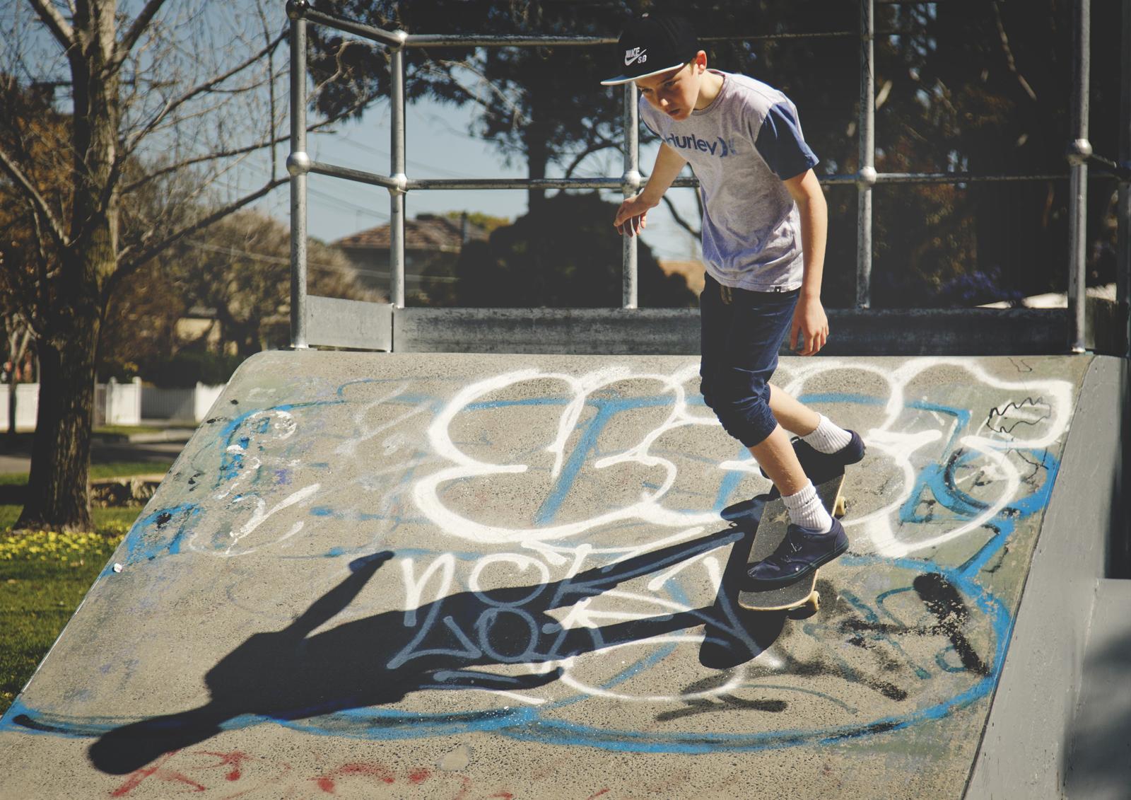 Tween boy skateboarding!