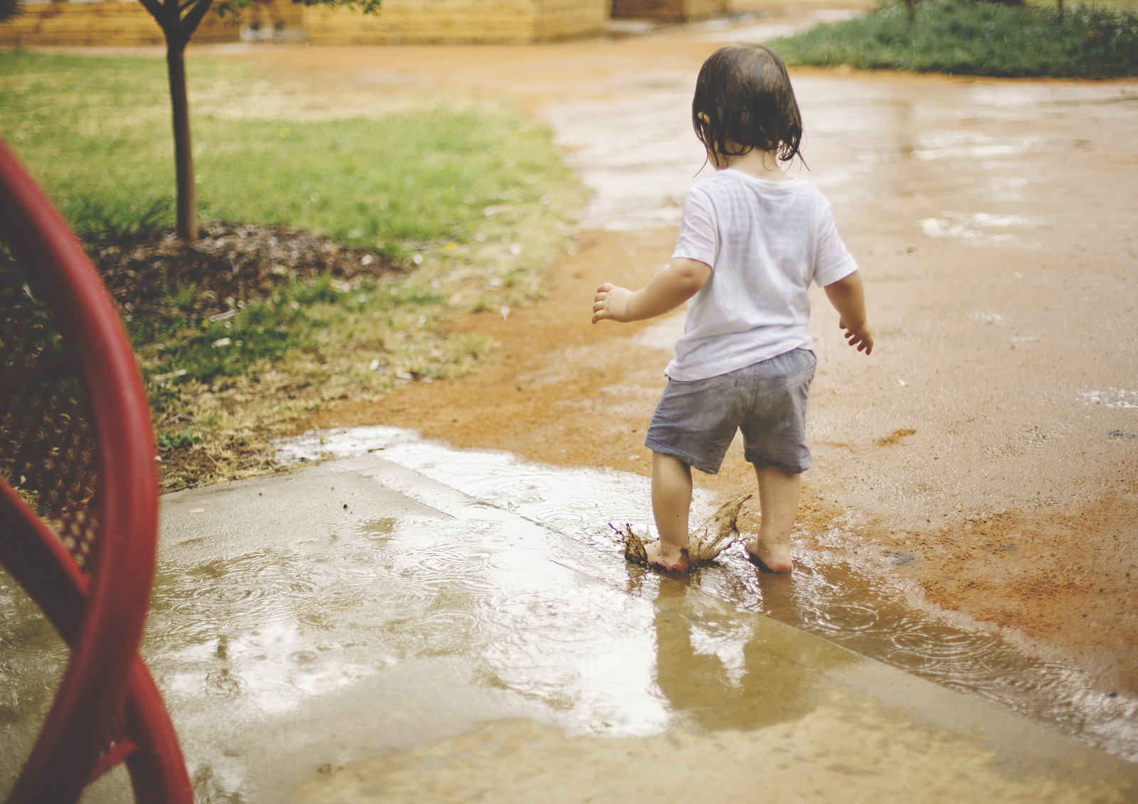 Jumping Toddler in muddy puddles!