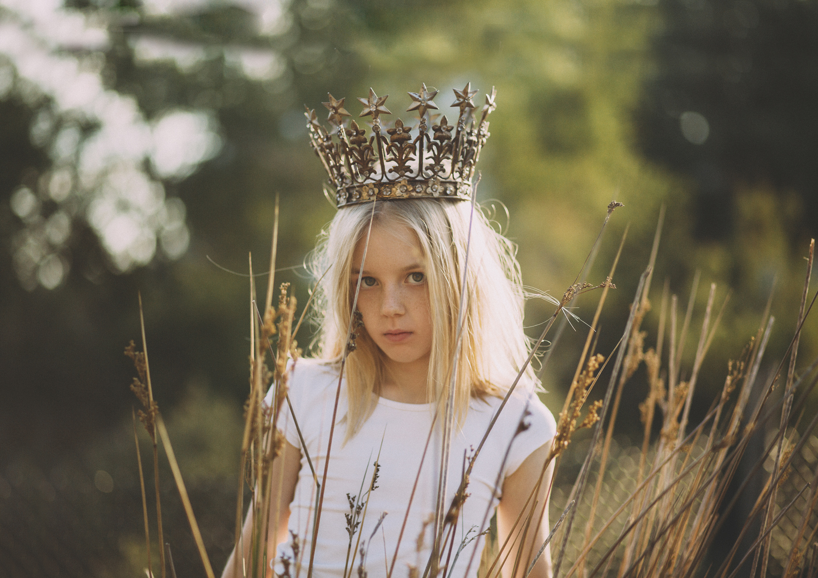 Little girl wearing gold crown!