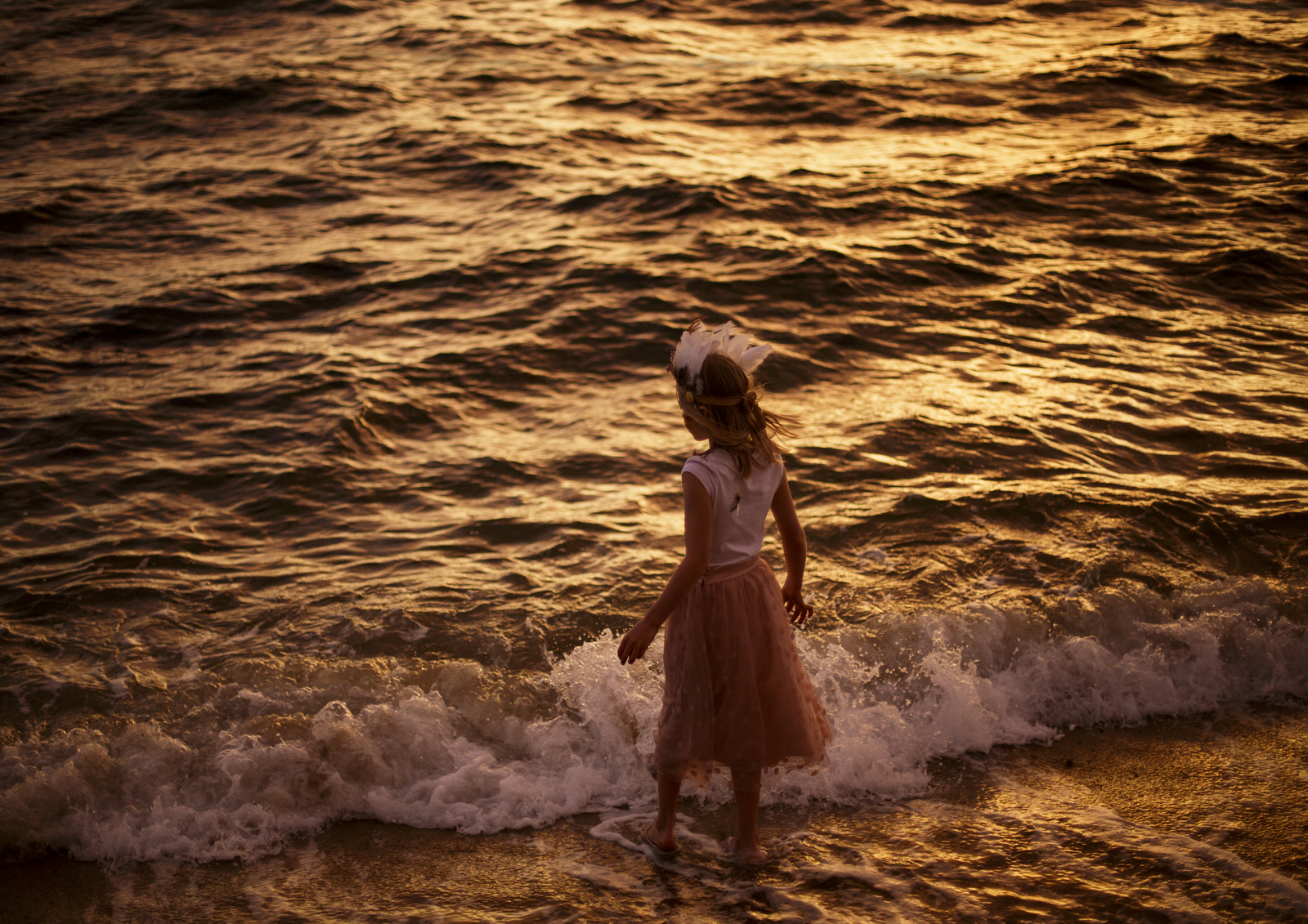 Child in the water with waves