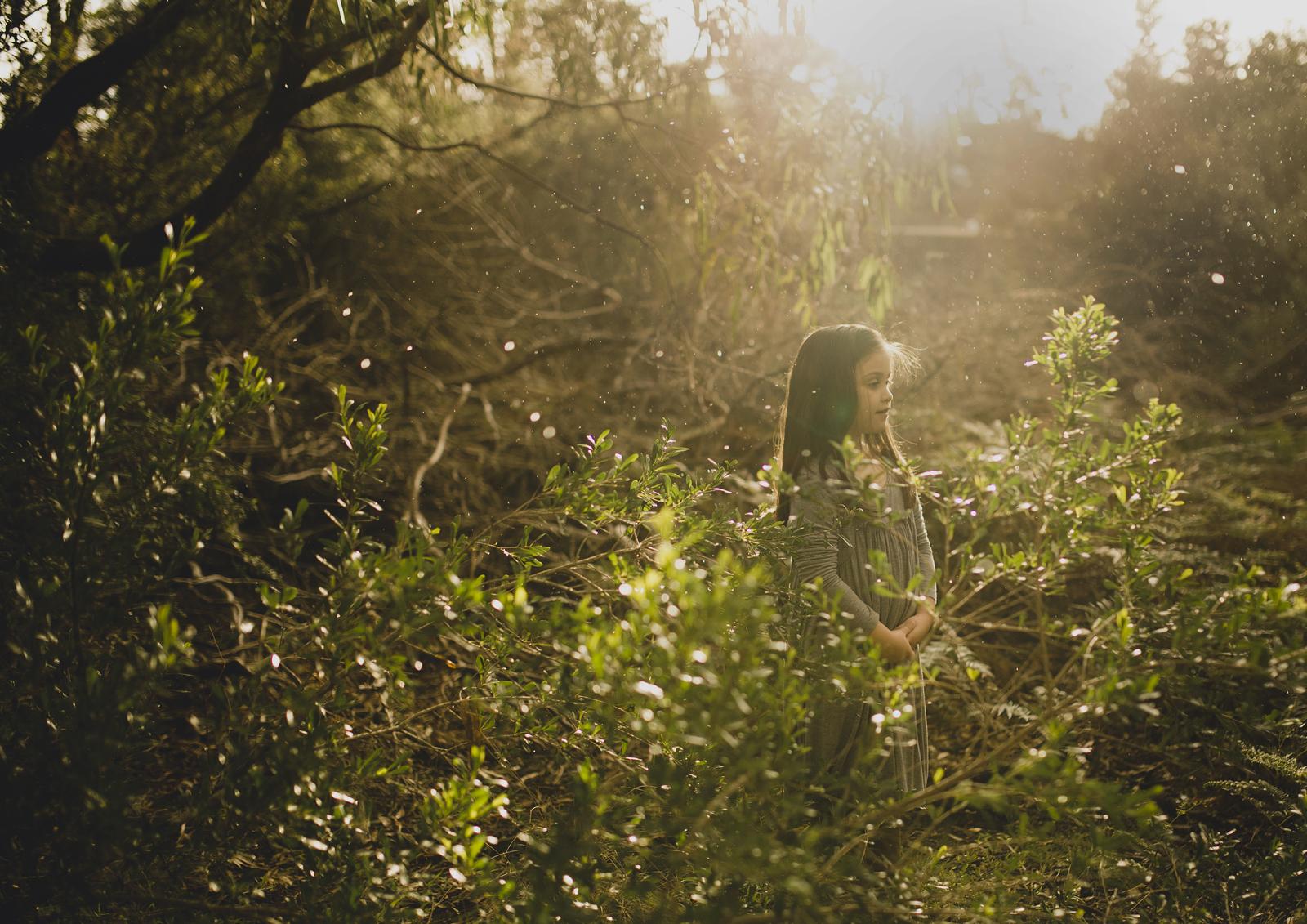Little girl on an adventure in shrub land!