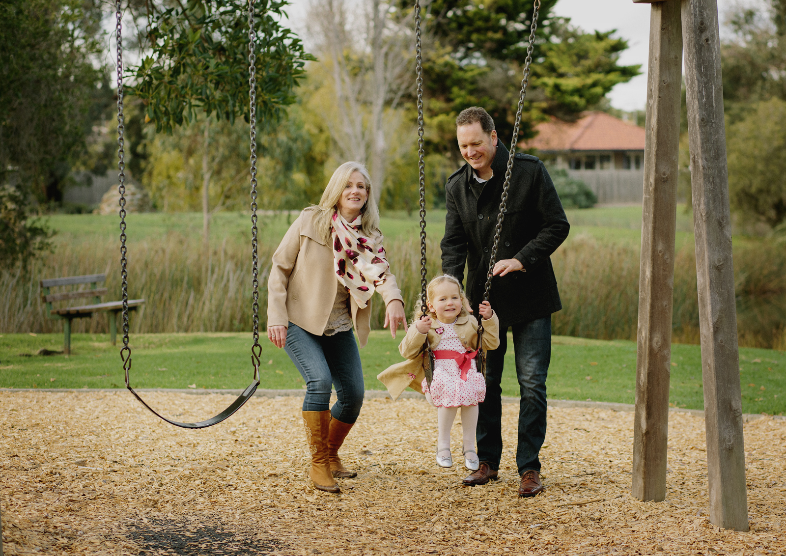 Family playing on the swings at the park!