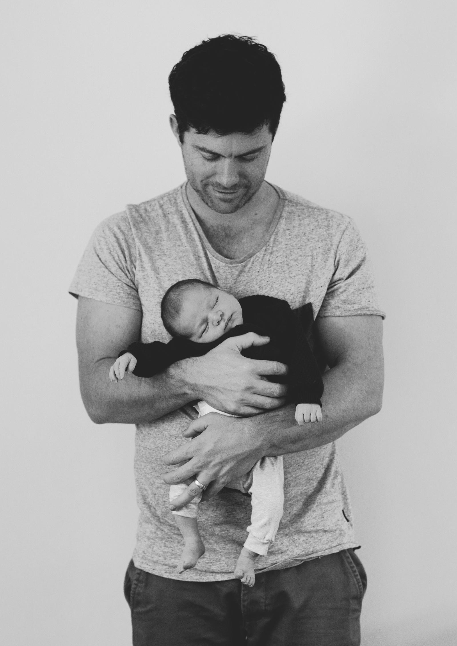 Dad holding newborn baby!