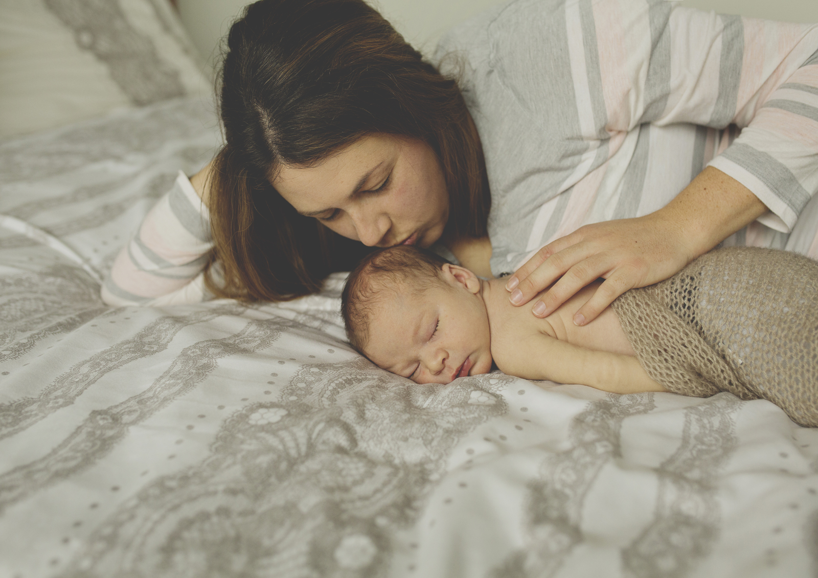 Mummy kissing newborn baby!