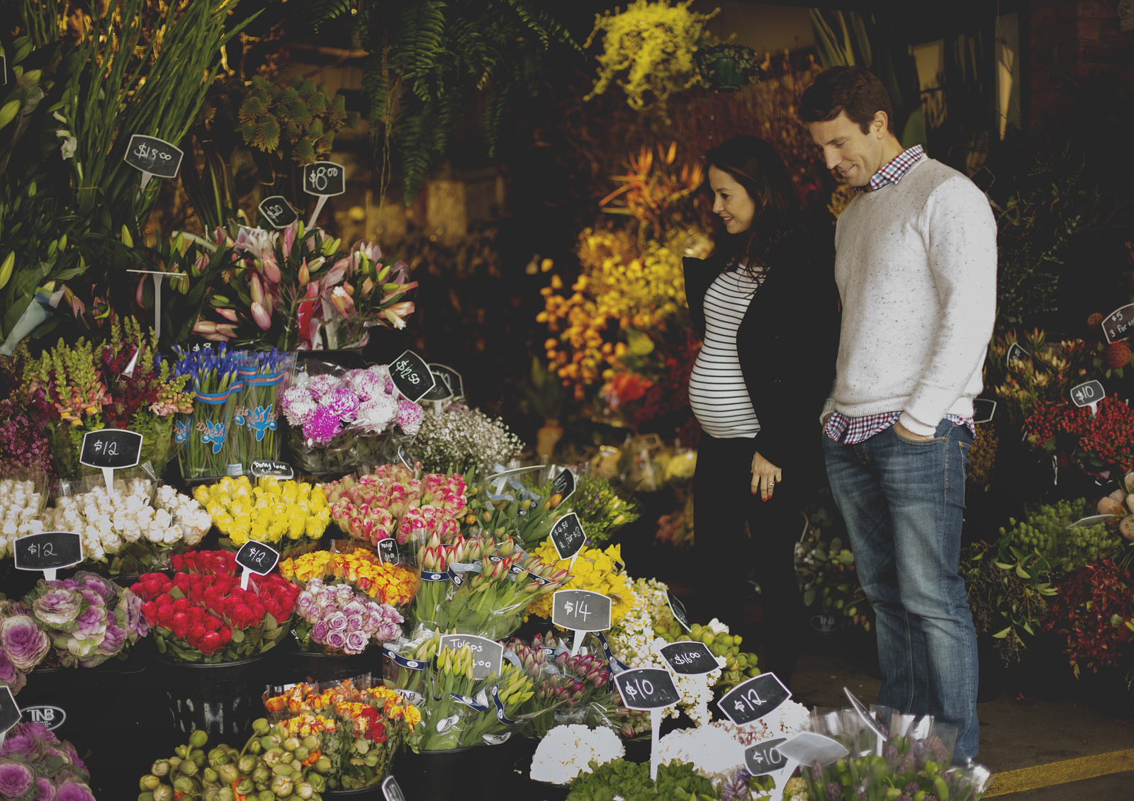 New expecting parents looking at flowers!