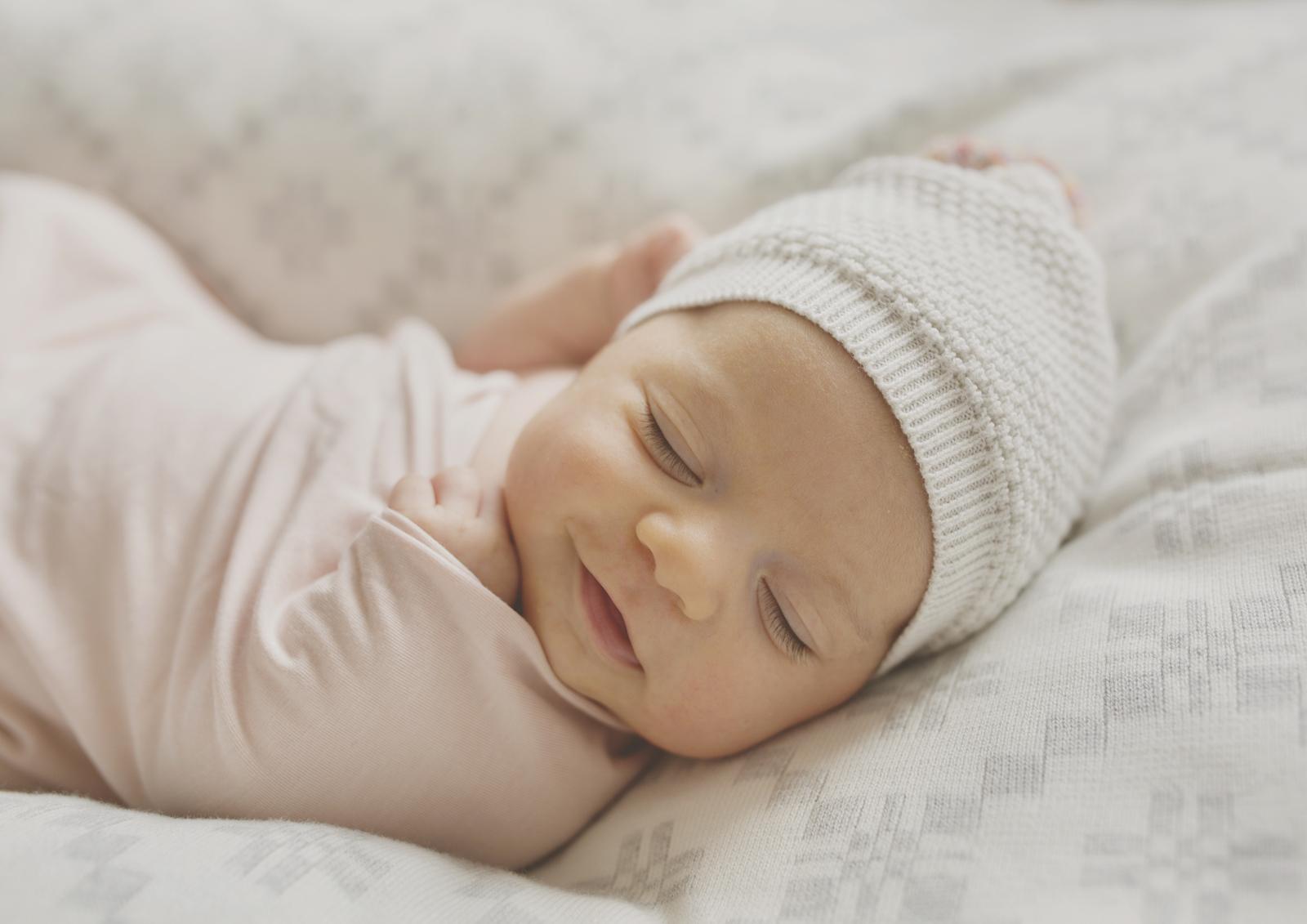 Smiling newborn baby girl!