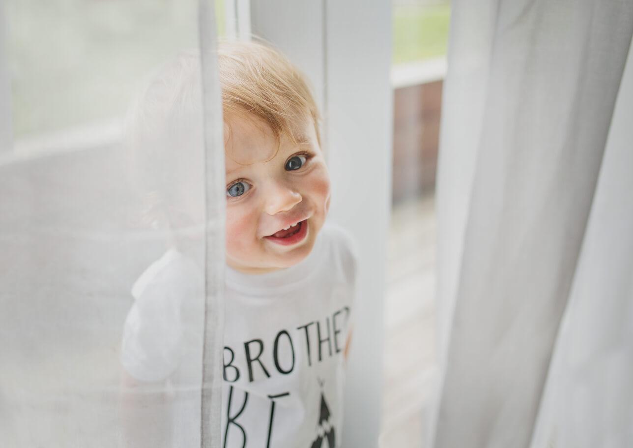 Toddler playing peek a boo!