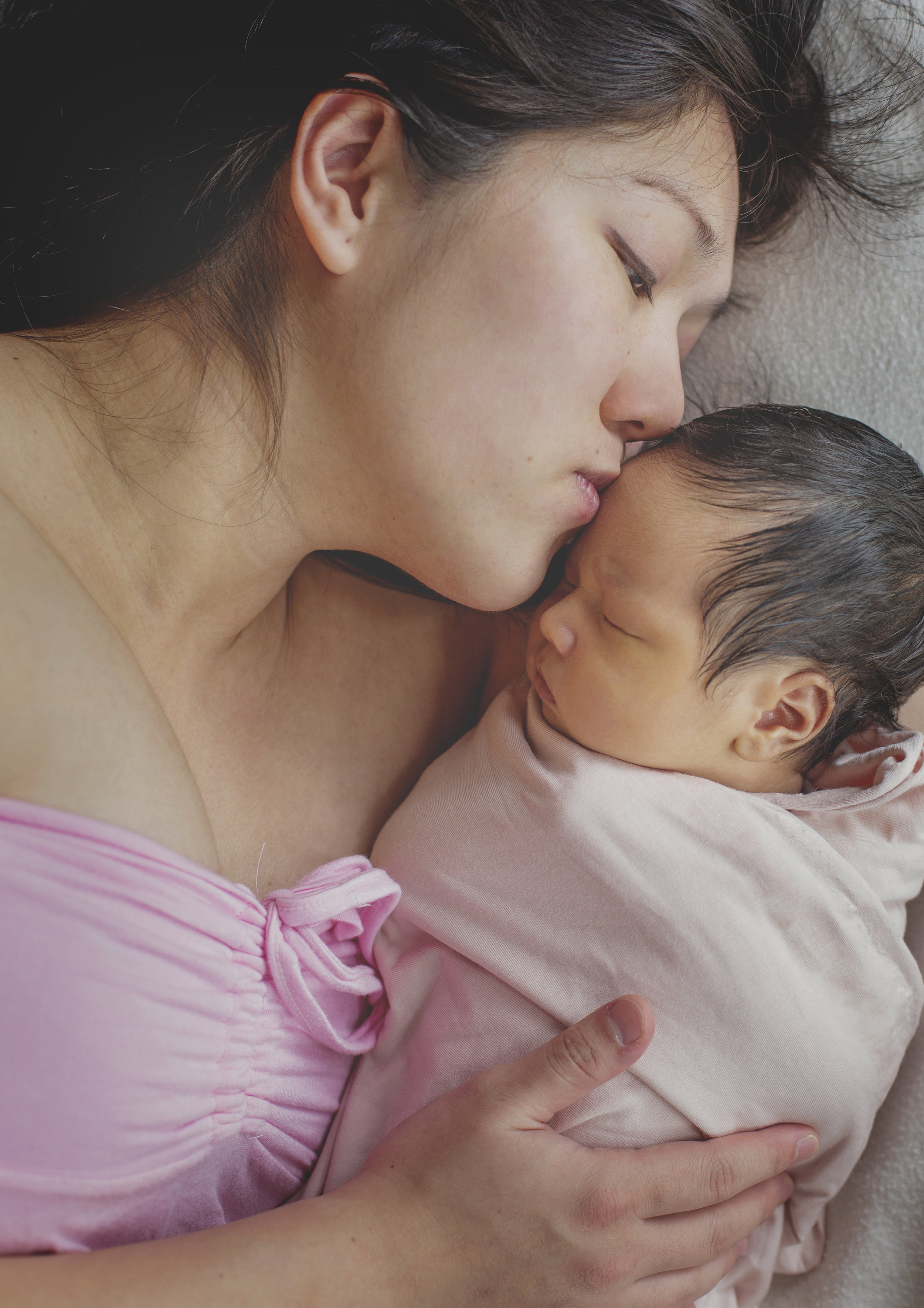 Mother kissing her newborn baby girl!