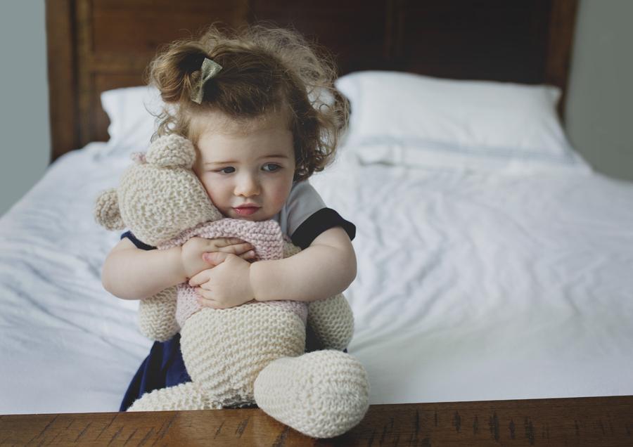 Toddler cuddling her teddy!