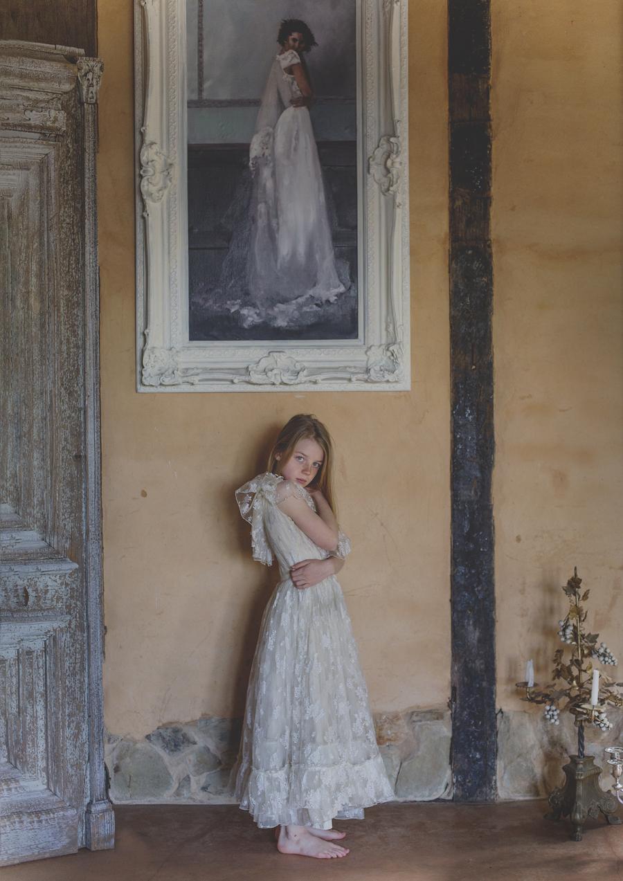 Young tween girl imitating painting