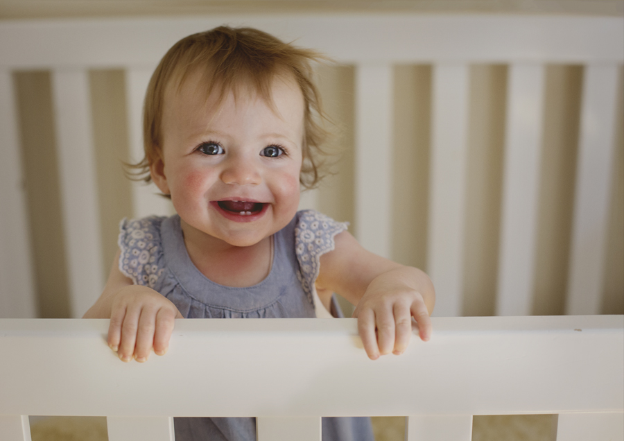 Baby playing in her cot!