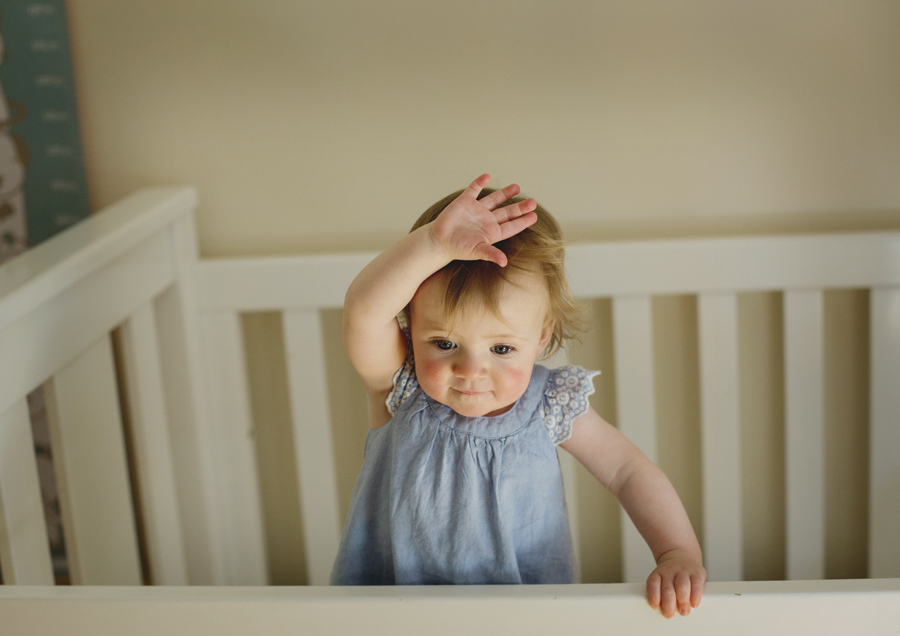 Toddler dancing in her cot!