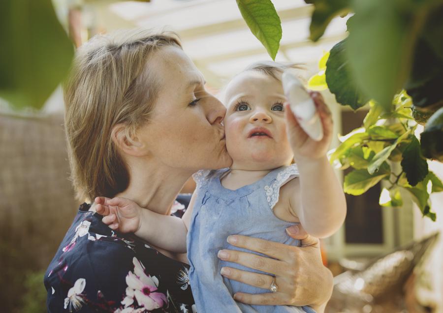Mum giving her toddler a kiss!