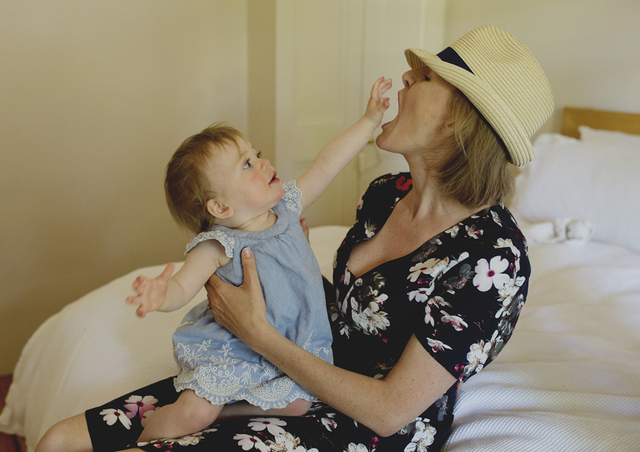 Baby toddler trying to get her Mum's hat!