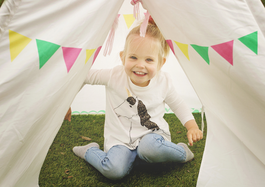 Toddler playing in her tee pee!