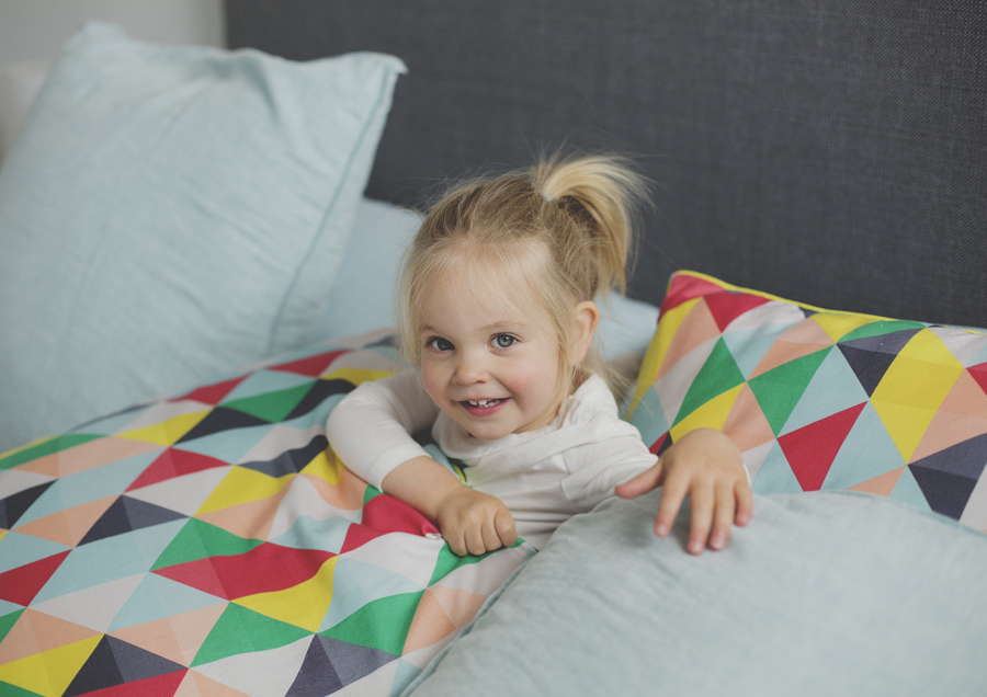 Toddler playing in Mum & Dad's bed