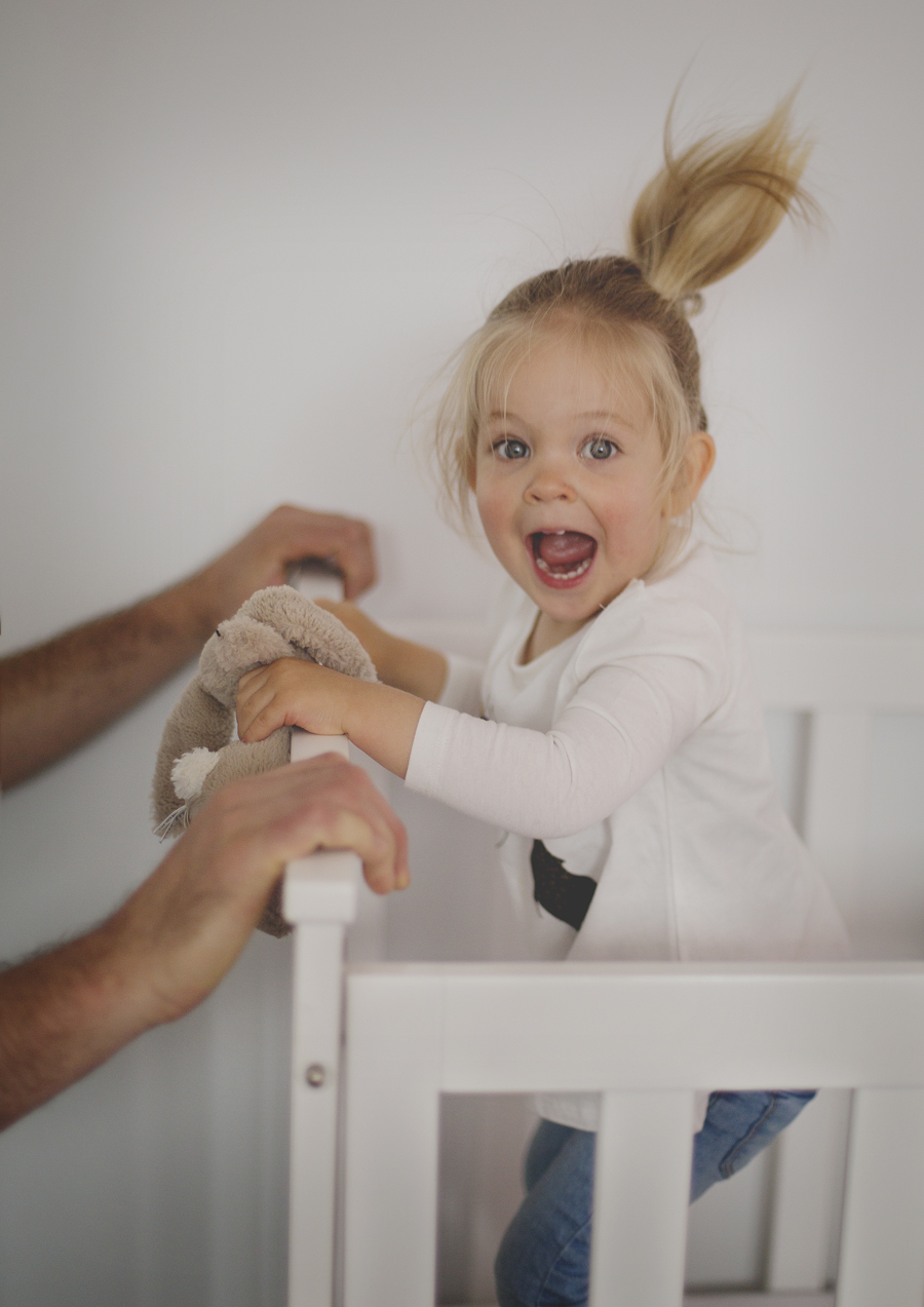 Toddler jumping in her cot!