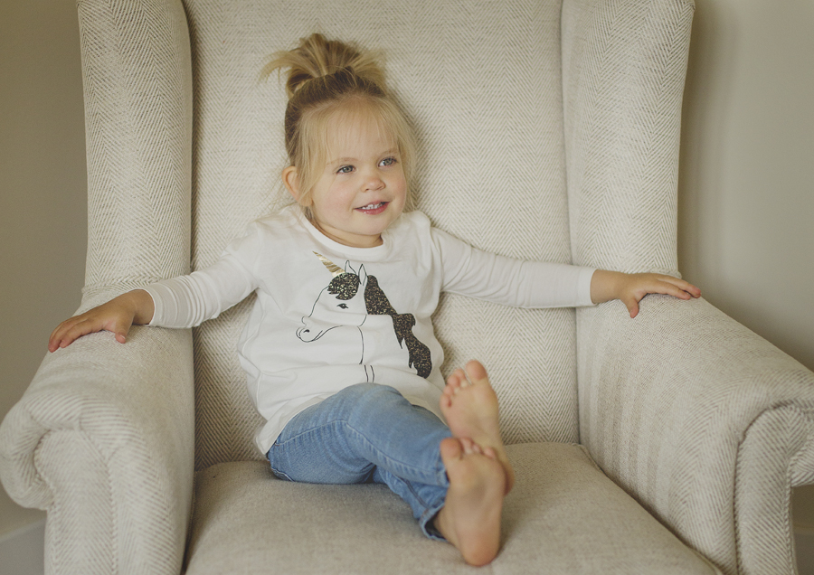 Little Toddler sitting in a big chair