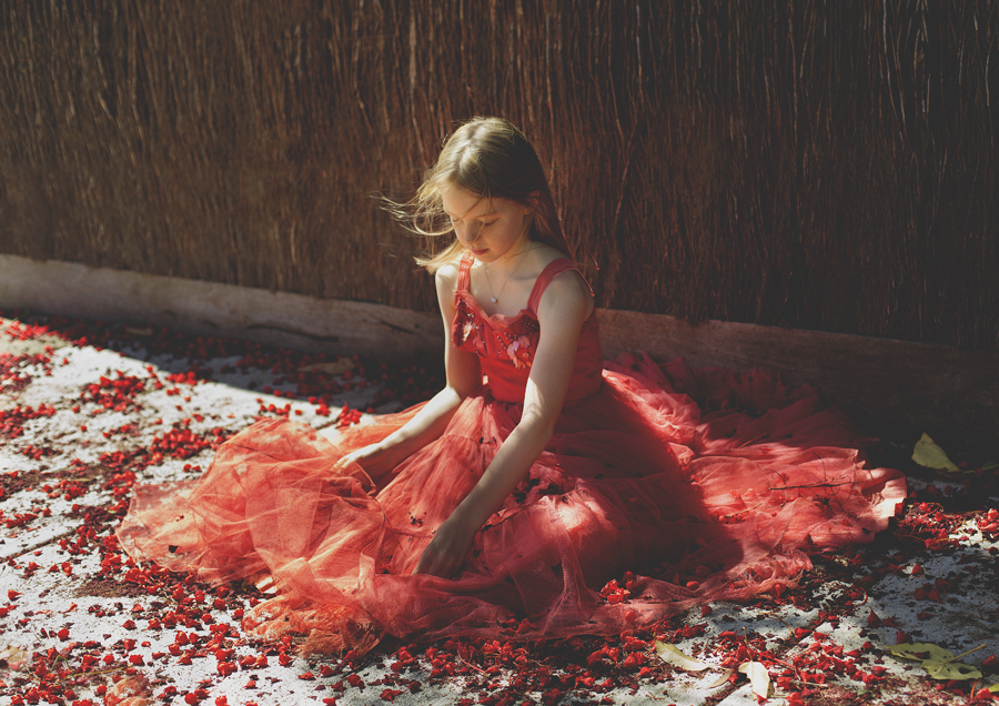 Photo of Tween girl in red vintage dress