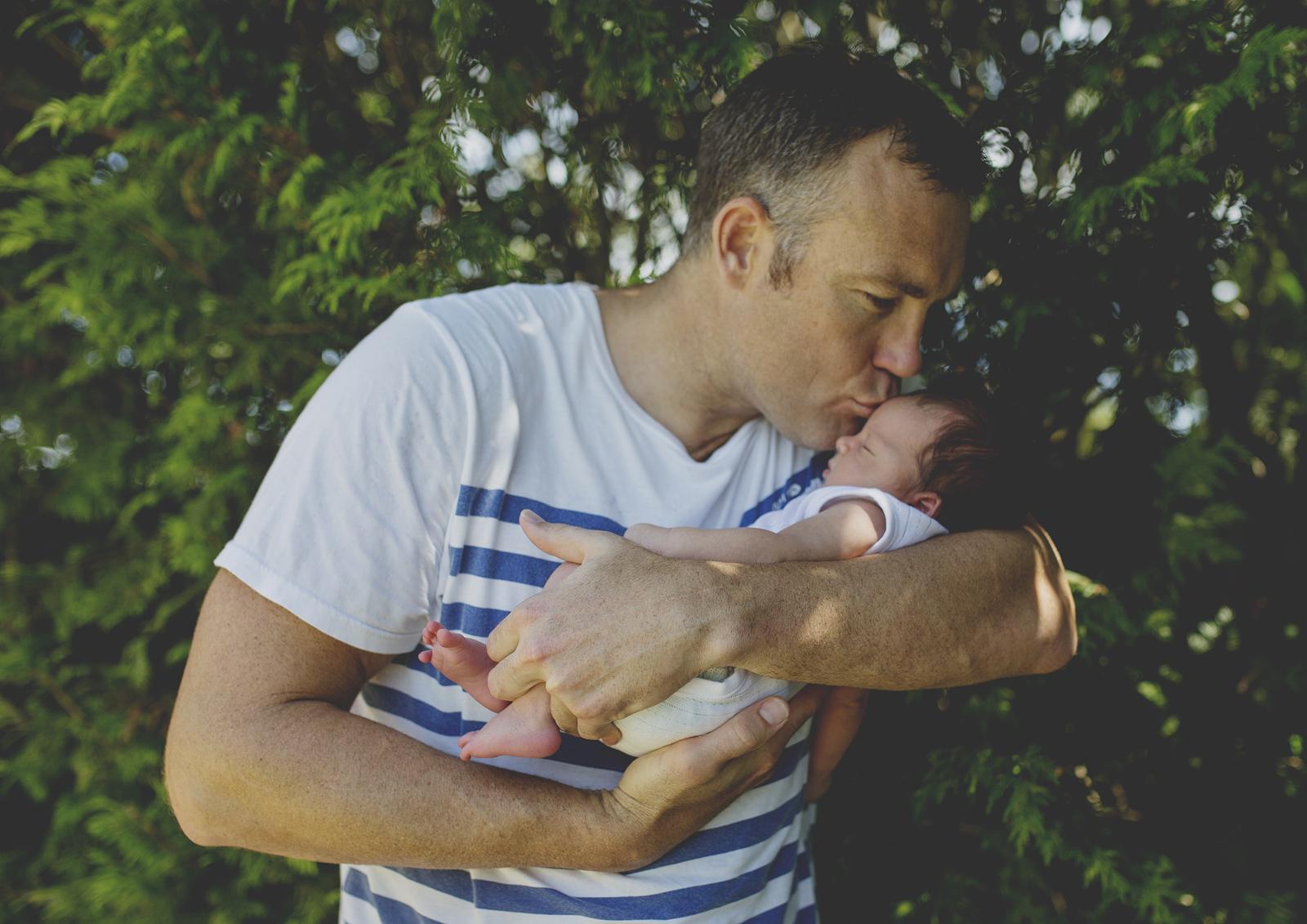 Father kissing his newborn baby boy!