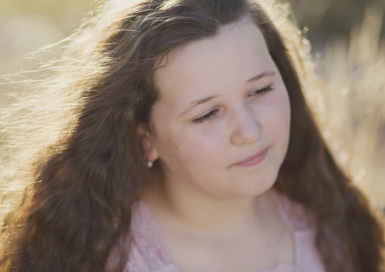 Back lit image of Tween Girl at the park