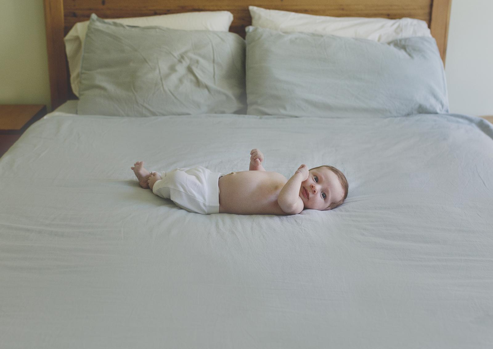 Newborn baby boy on parents bed!
