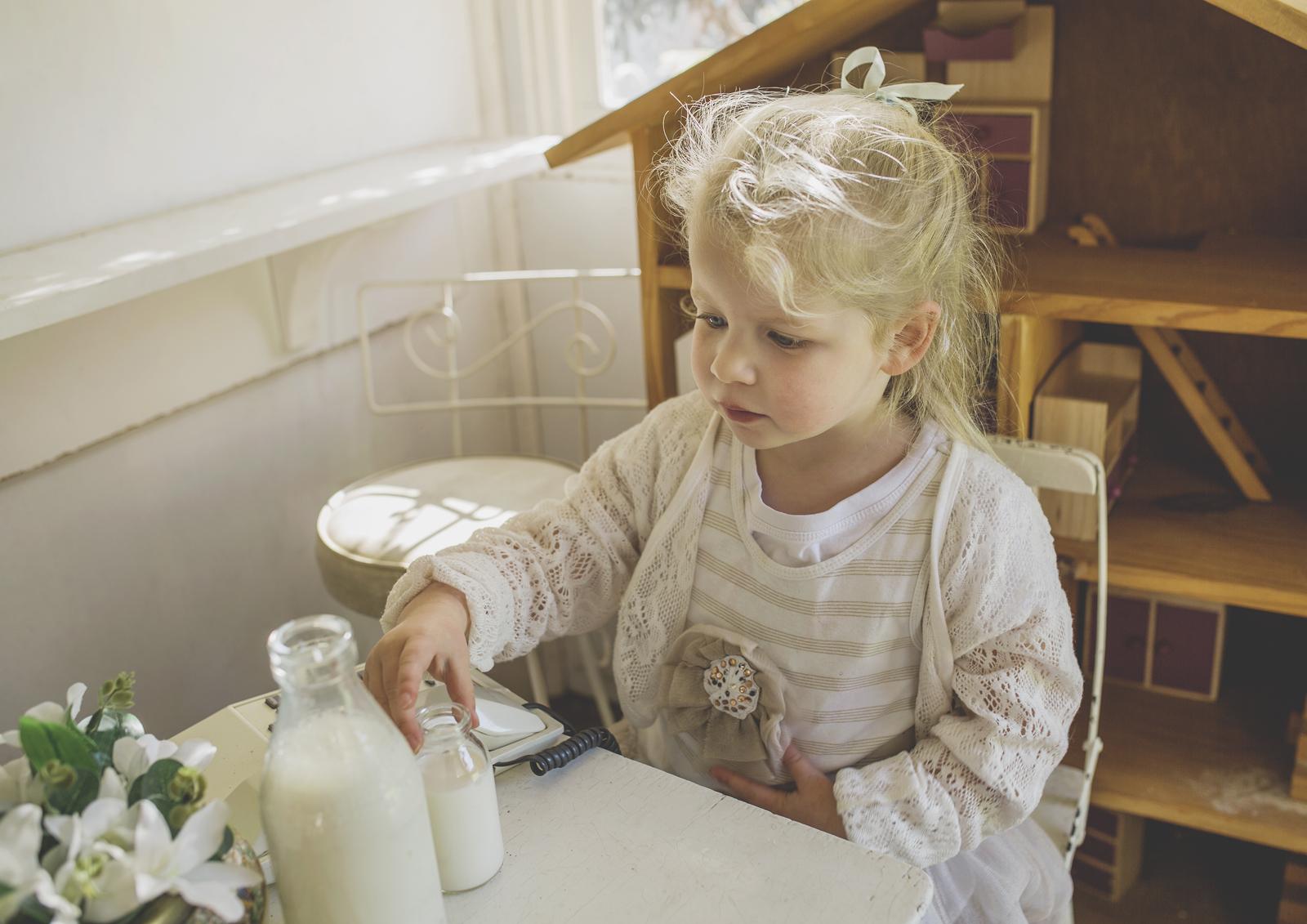 Little girl having morning tea in her cubby!