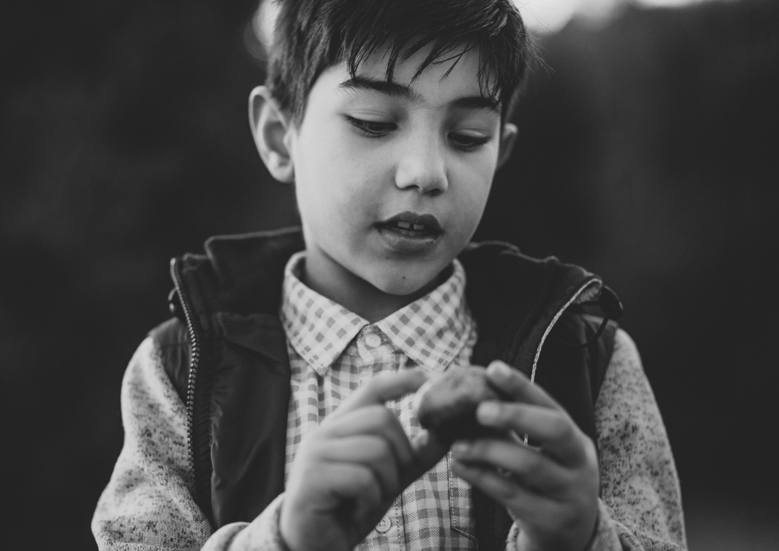 Young boy playing with a rock