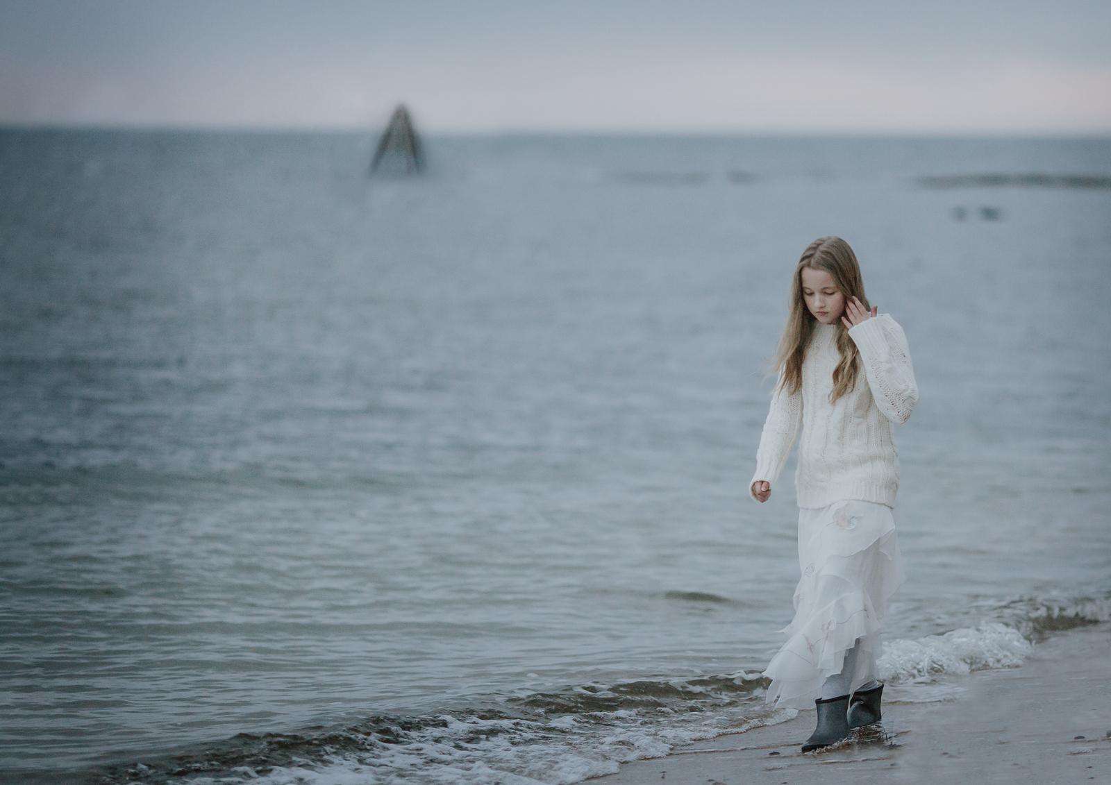 Young Tween girl walking along the Bayside beach