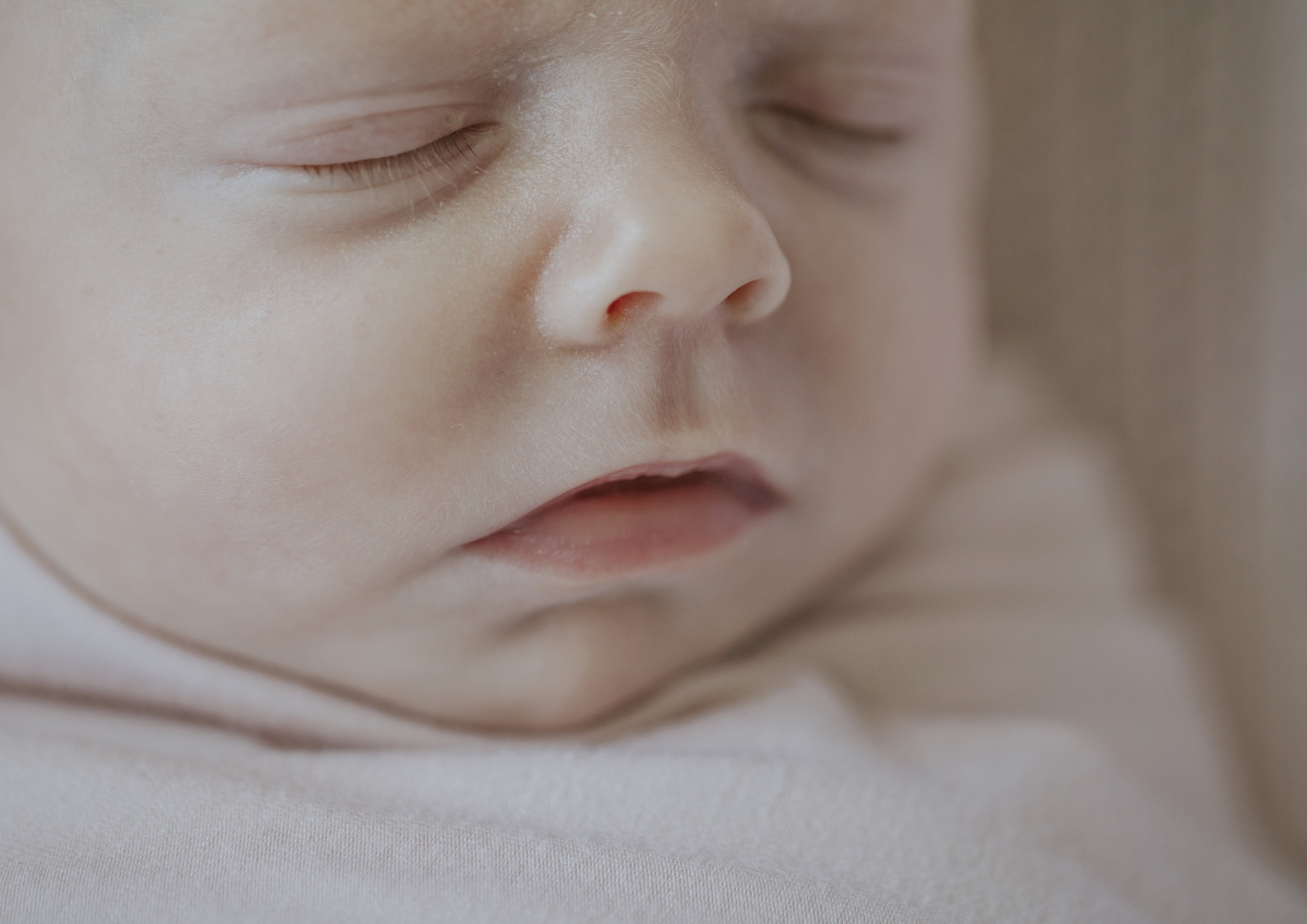 Close up photo of newborn baby's facial features
