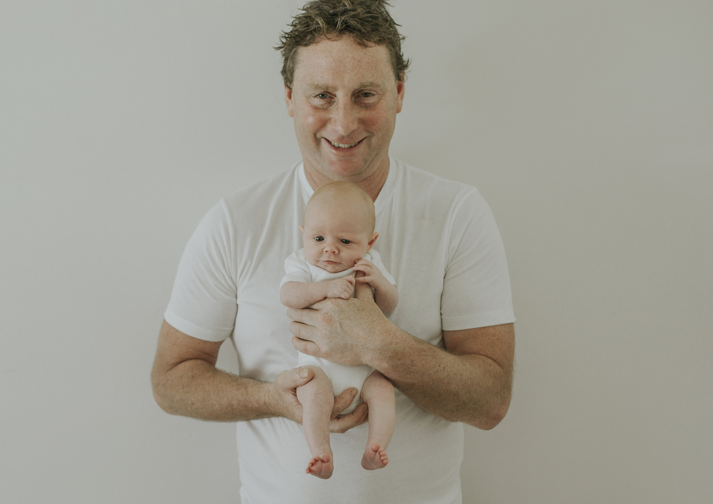 This Dad's a natural with his newborn baby girl