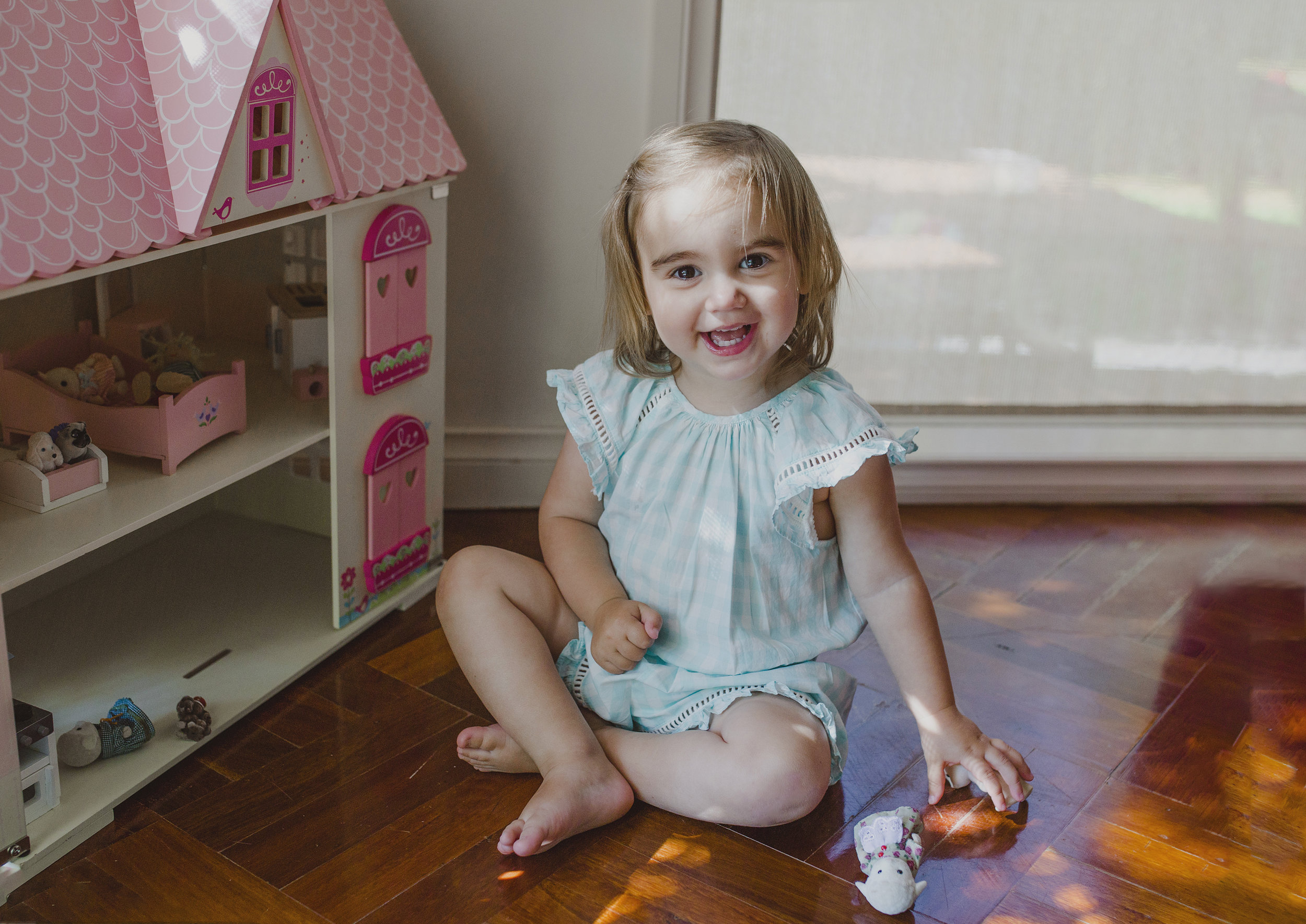 Toddler playing with her dollhouse!