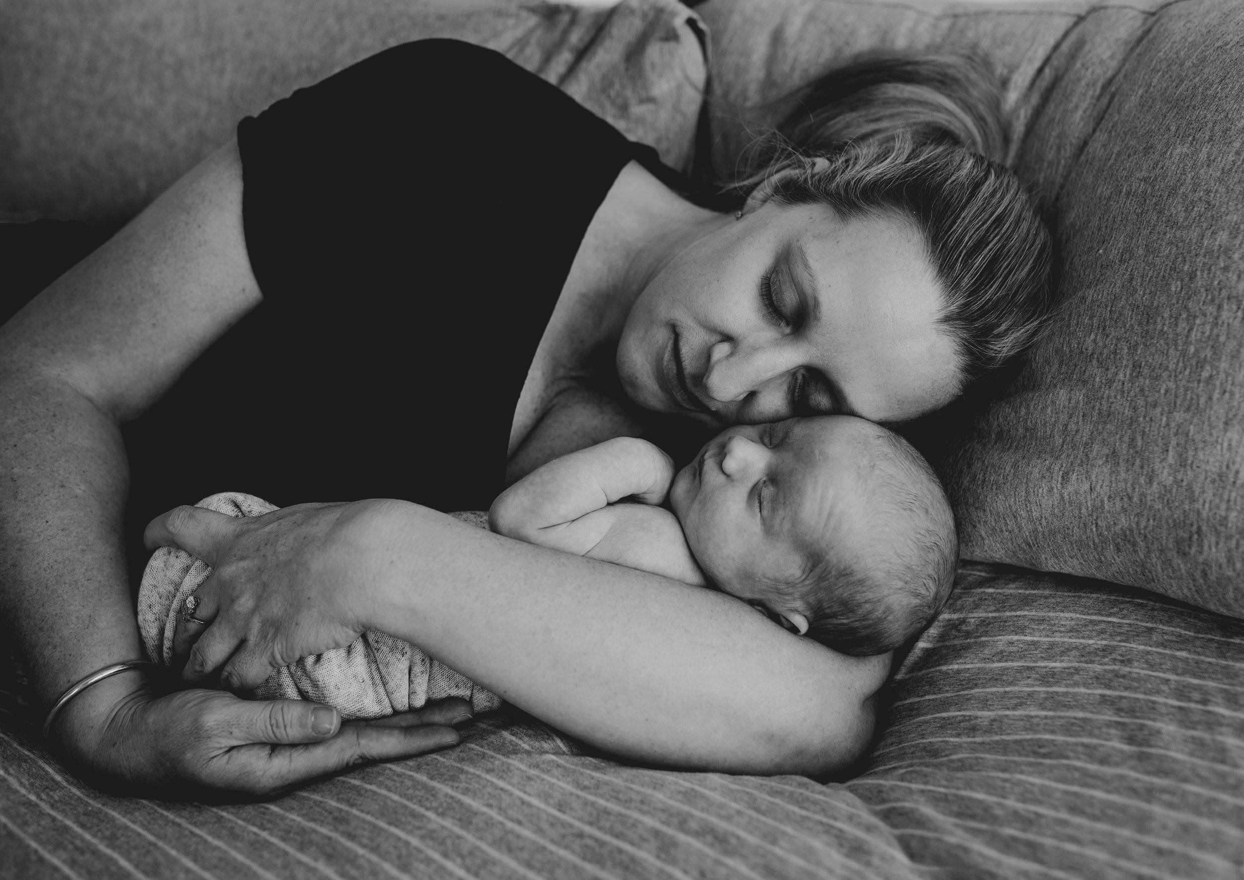 Sleeping mother and baby