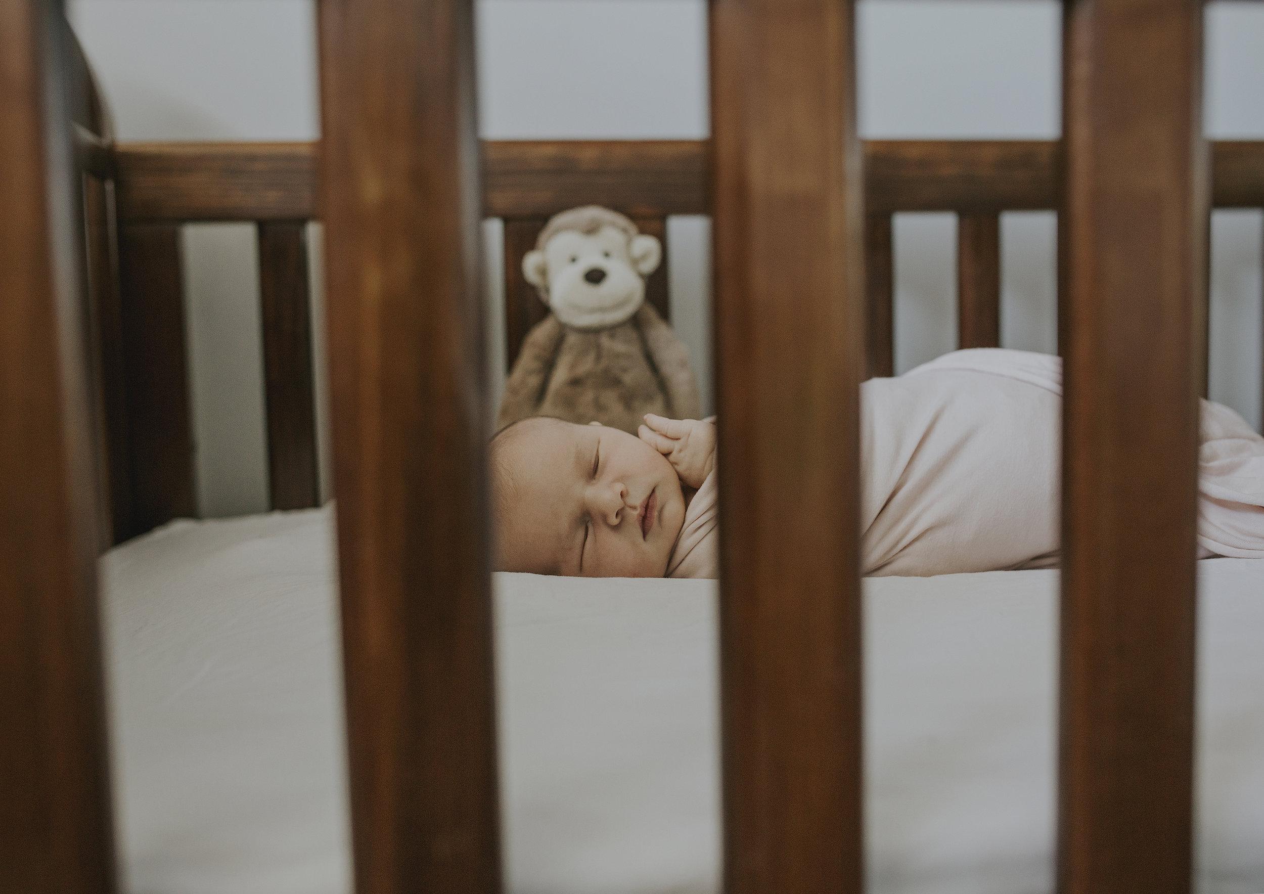 Newborn baby girl in her cot