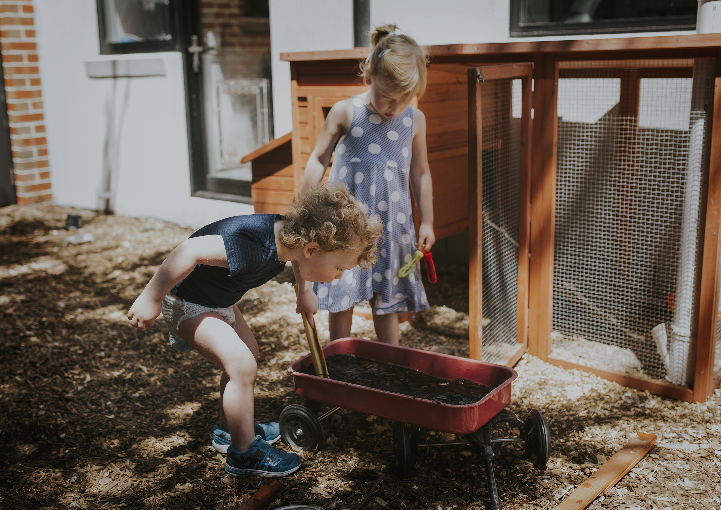 Children making mud pies in their backyard