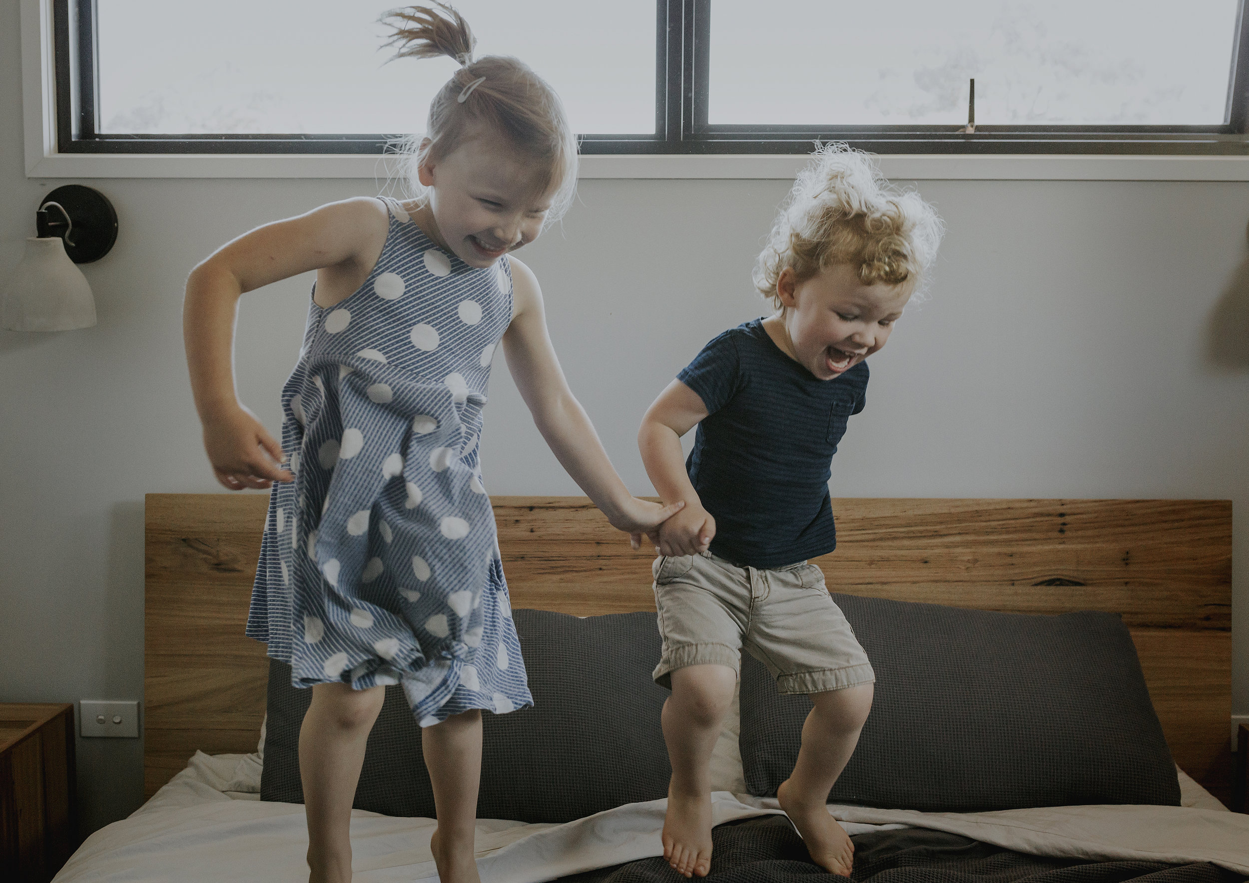 Children jumping on their parent's bed