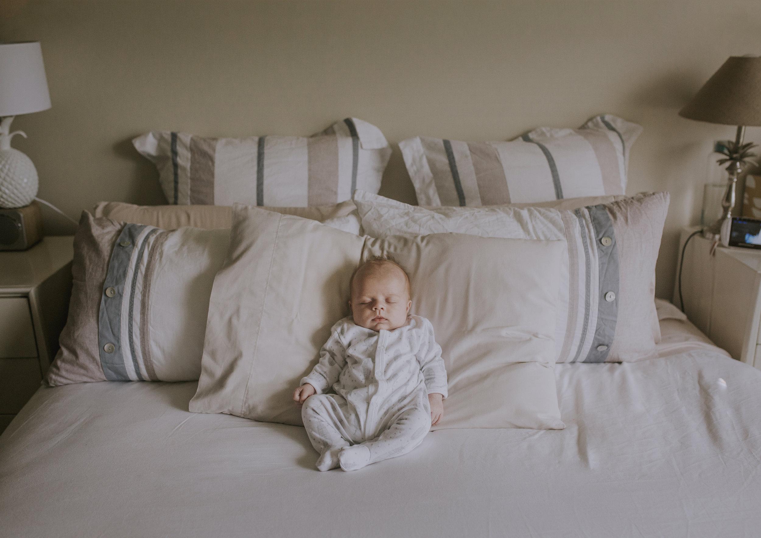 Newborn Baby Boy asleep on his parent's bed!
