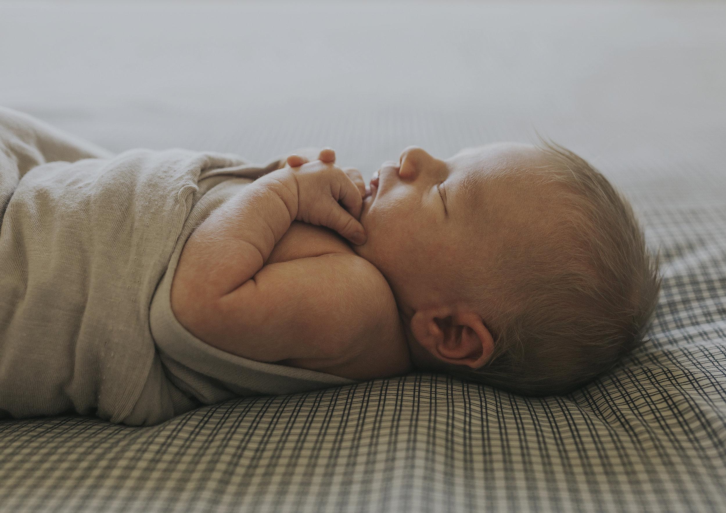 Side profile of a newborn baby boy