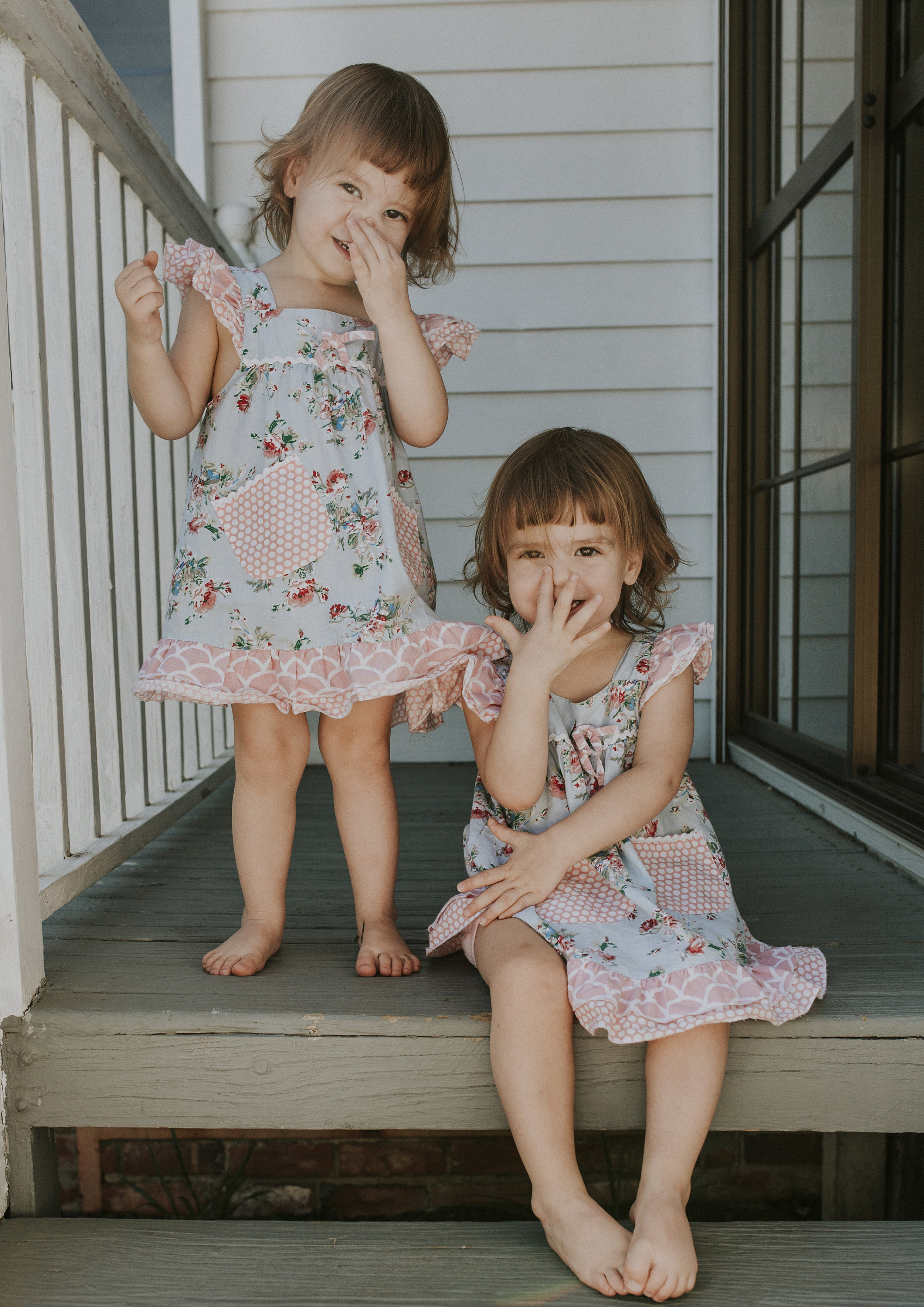 Toddler's touching their noses