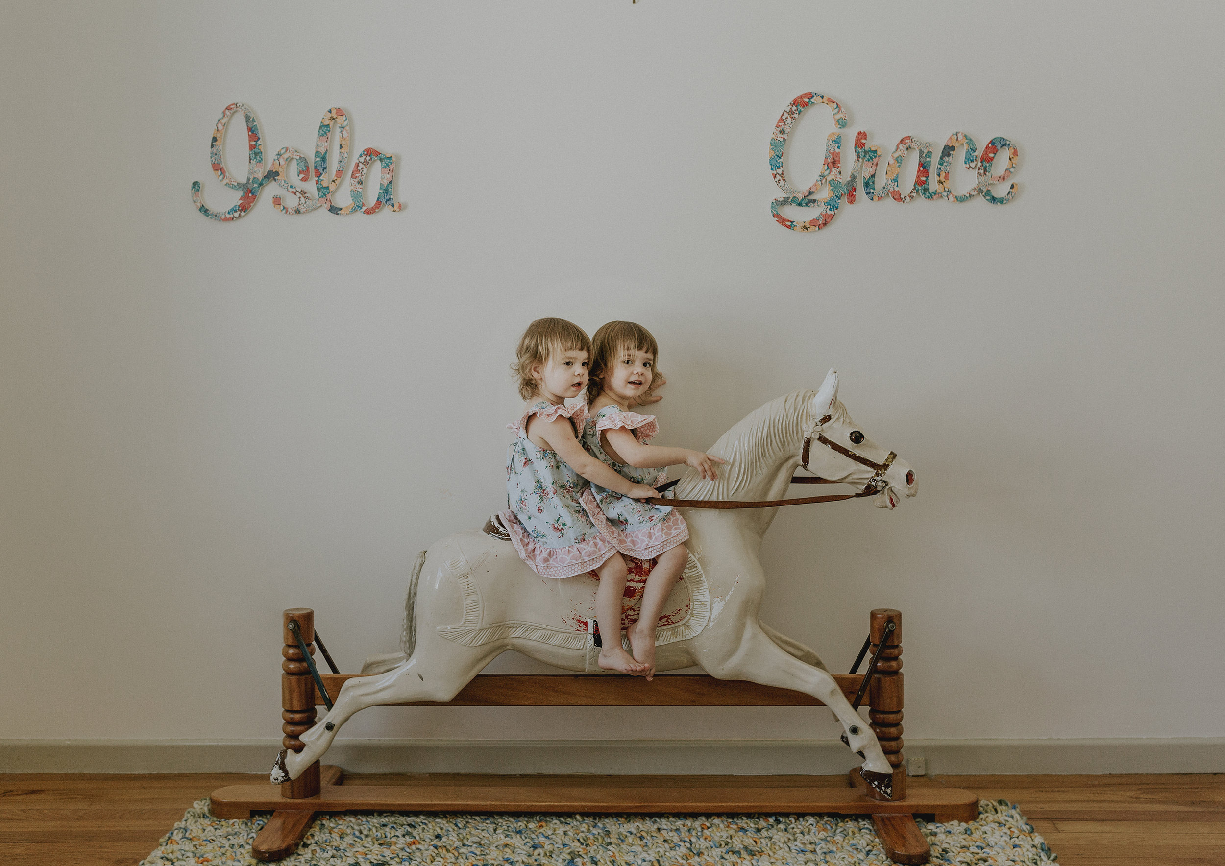 Toddler's riding on their toy horse