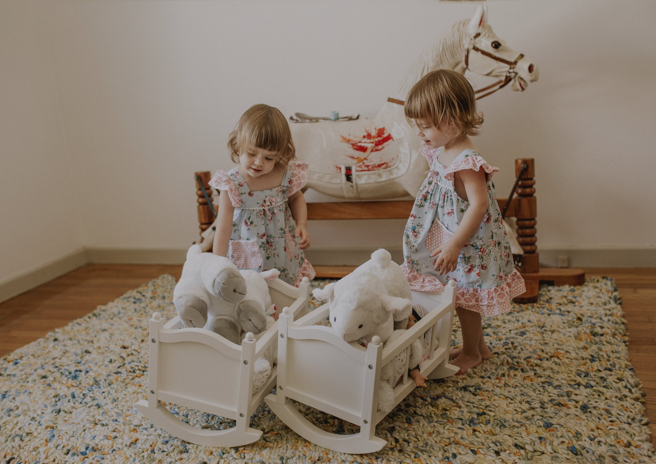 Twin girls playing with their dolls!